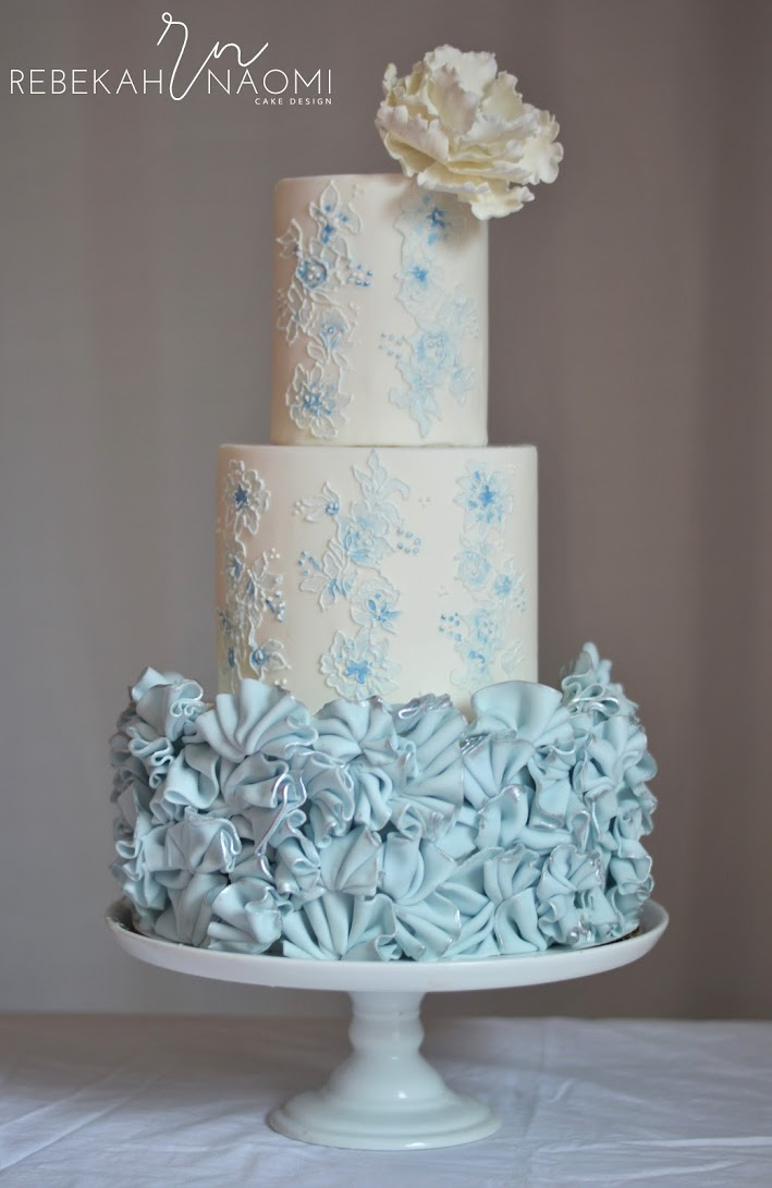 White wedding cake with baby blue ruffles