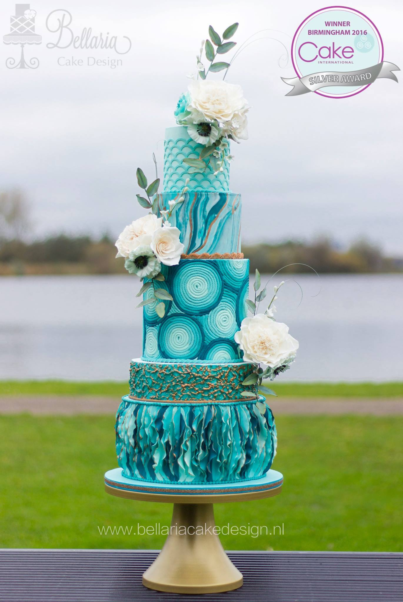 Turquoise blue and white mixed pattern wedding cake