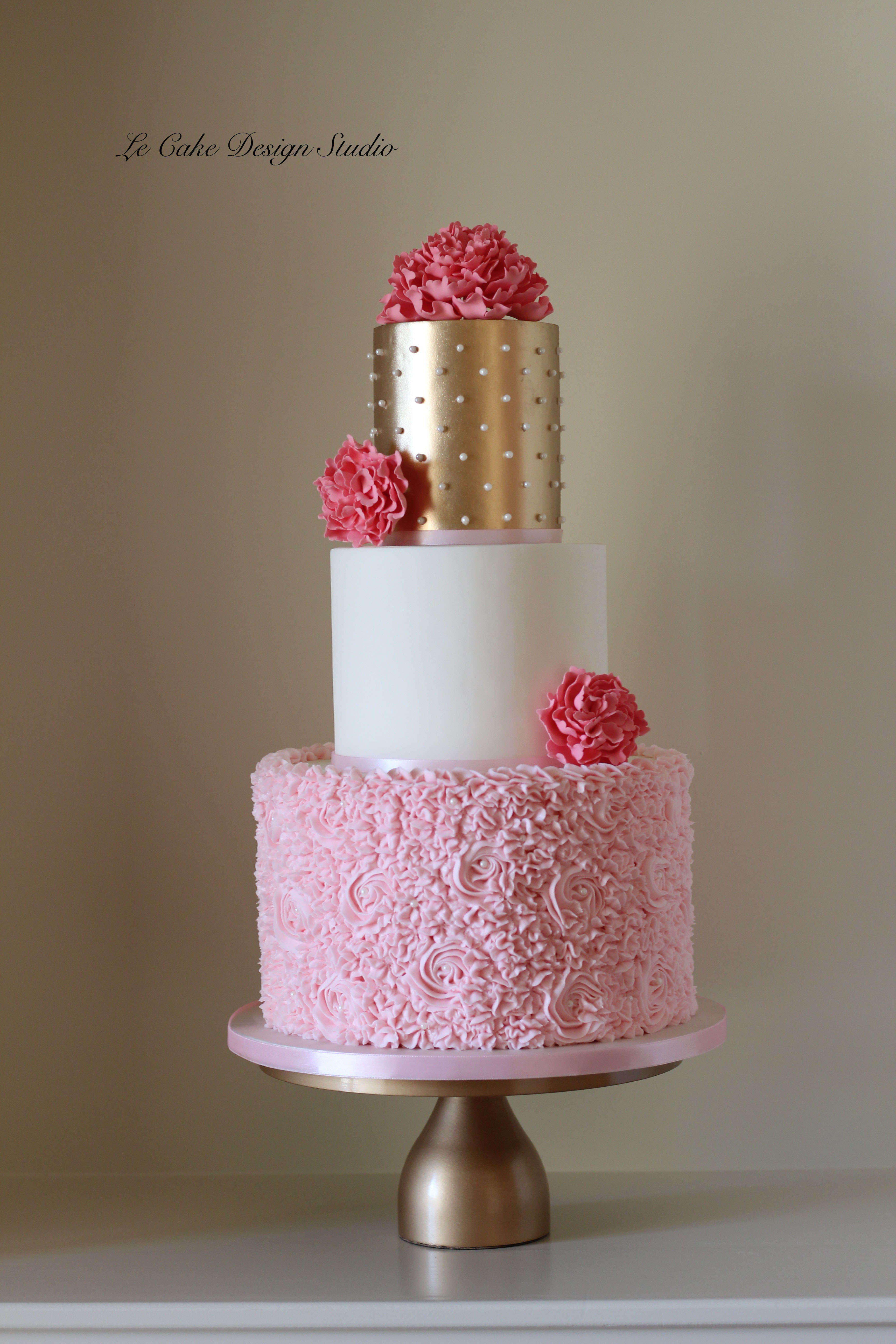 Pink Ruffled wedding cake with gold detailing