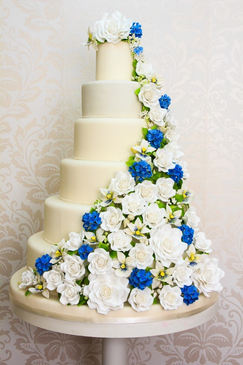 Ivory wedding with blue cascading flowers