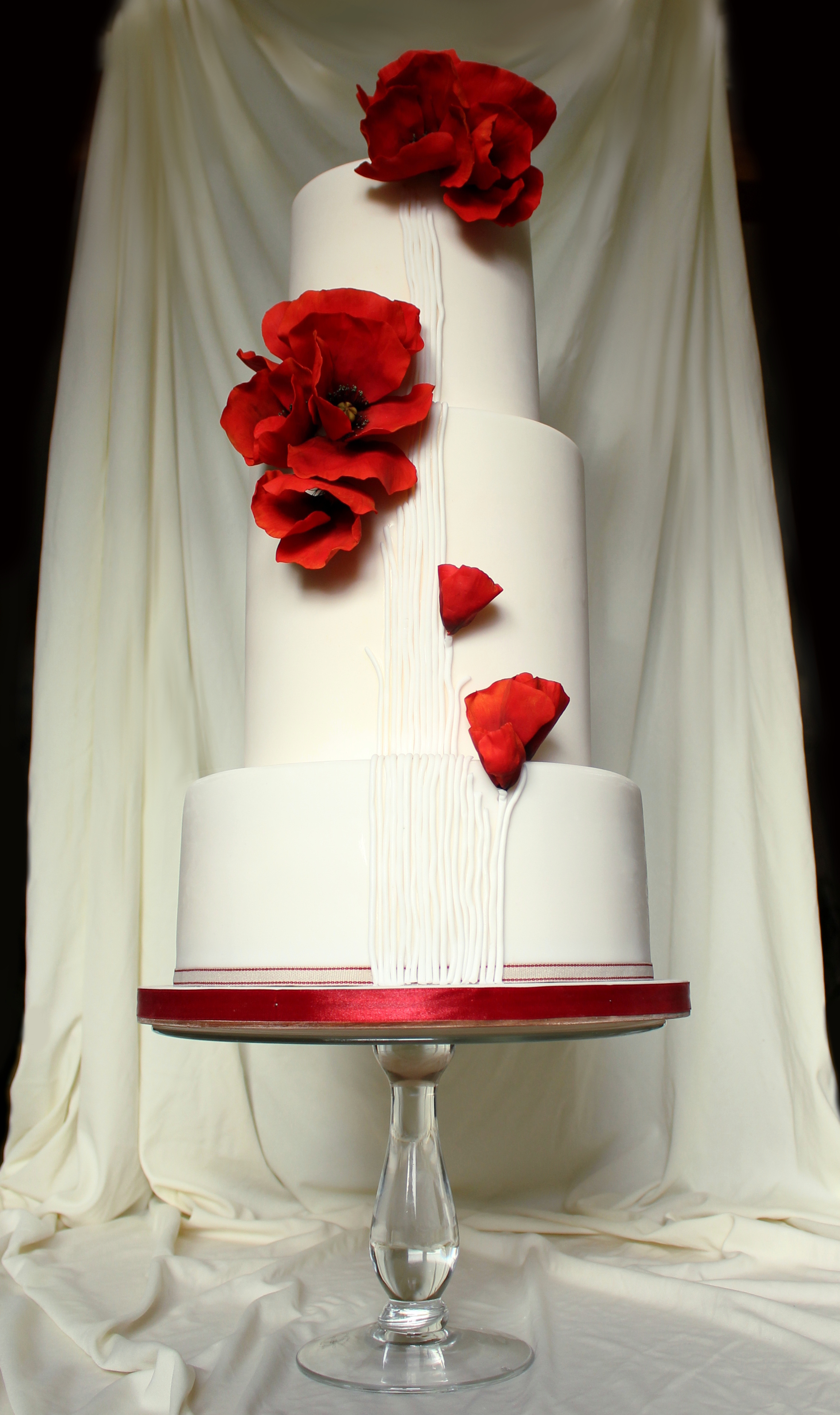 White wedding with red wafer flowers