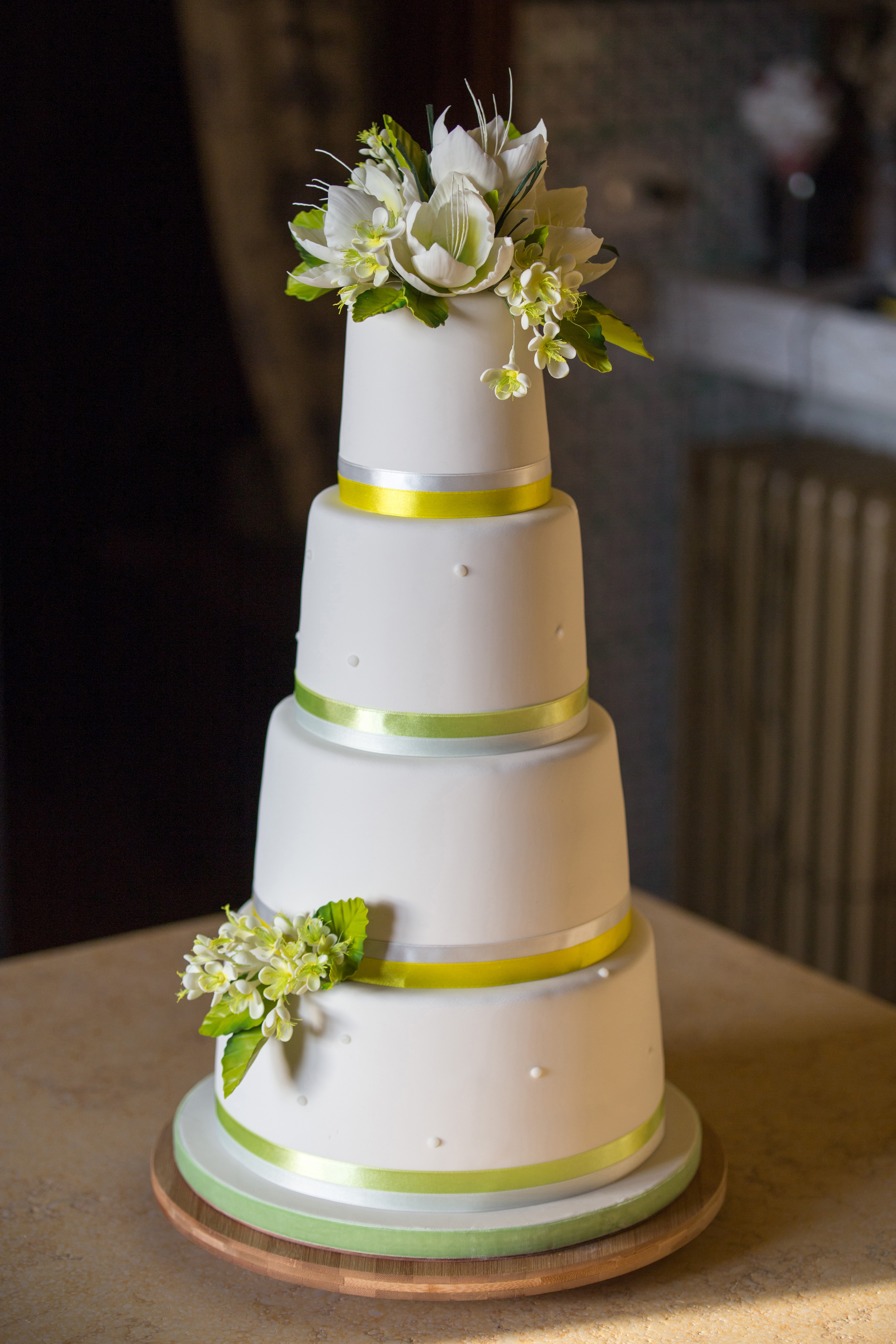 White with yellow sugar flowers wedding