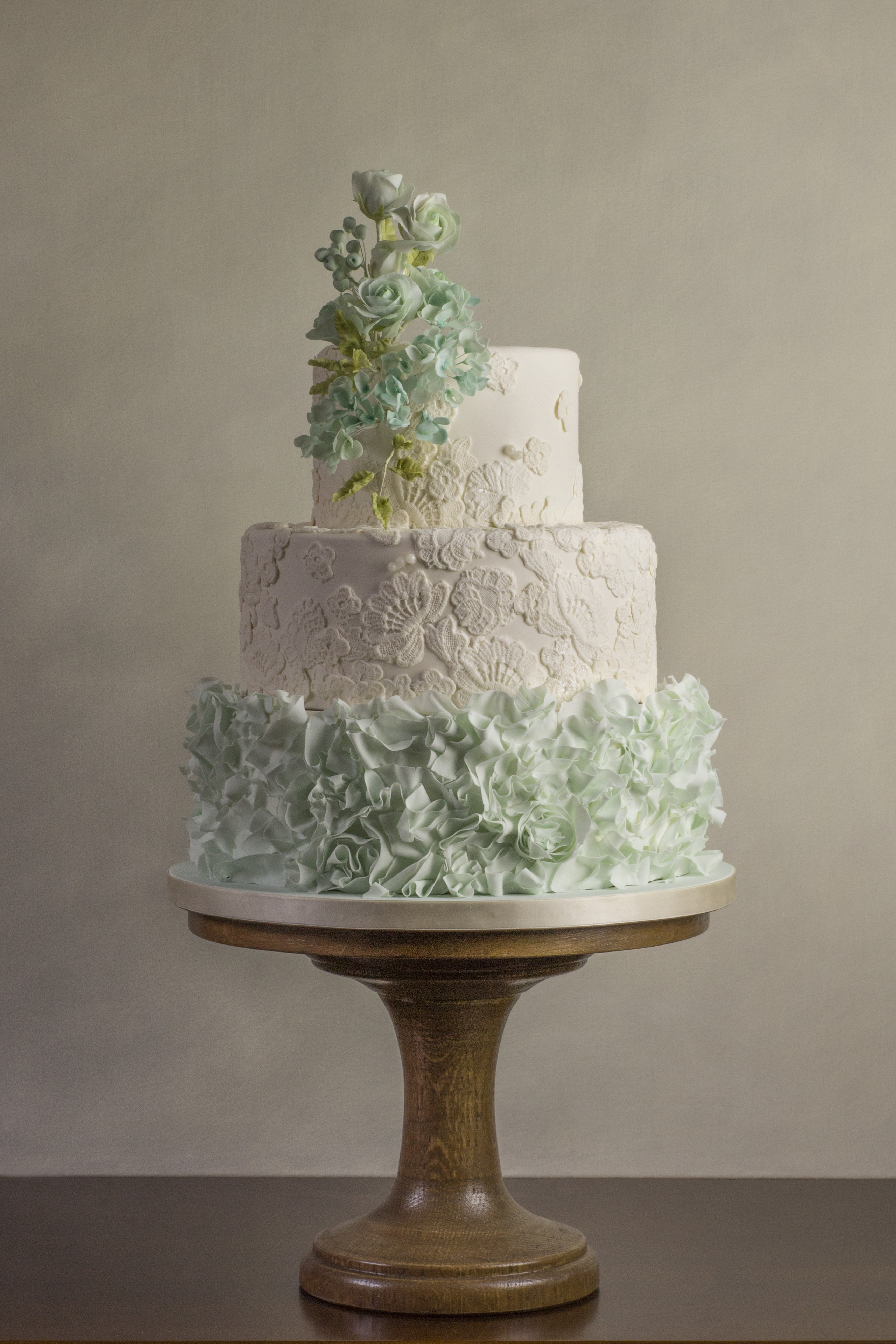 White and Pastel green ruffle ombre wedding cake with sugar flowers