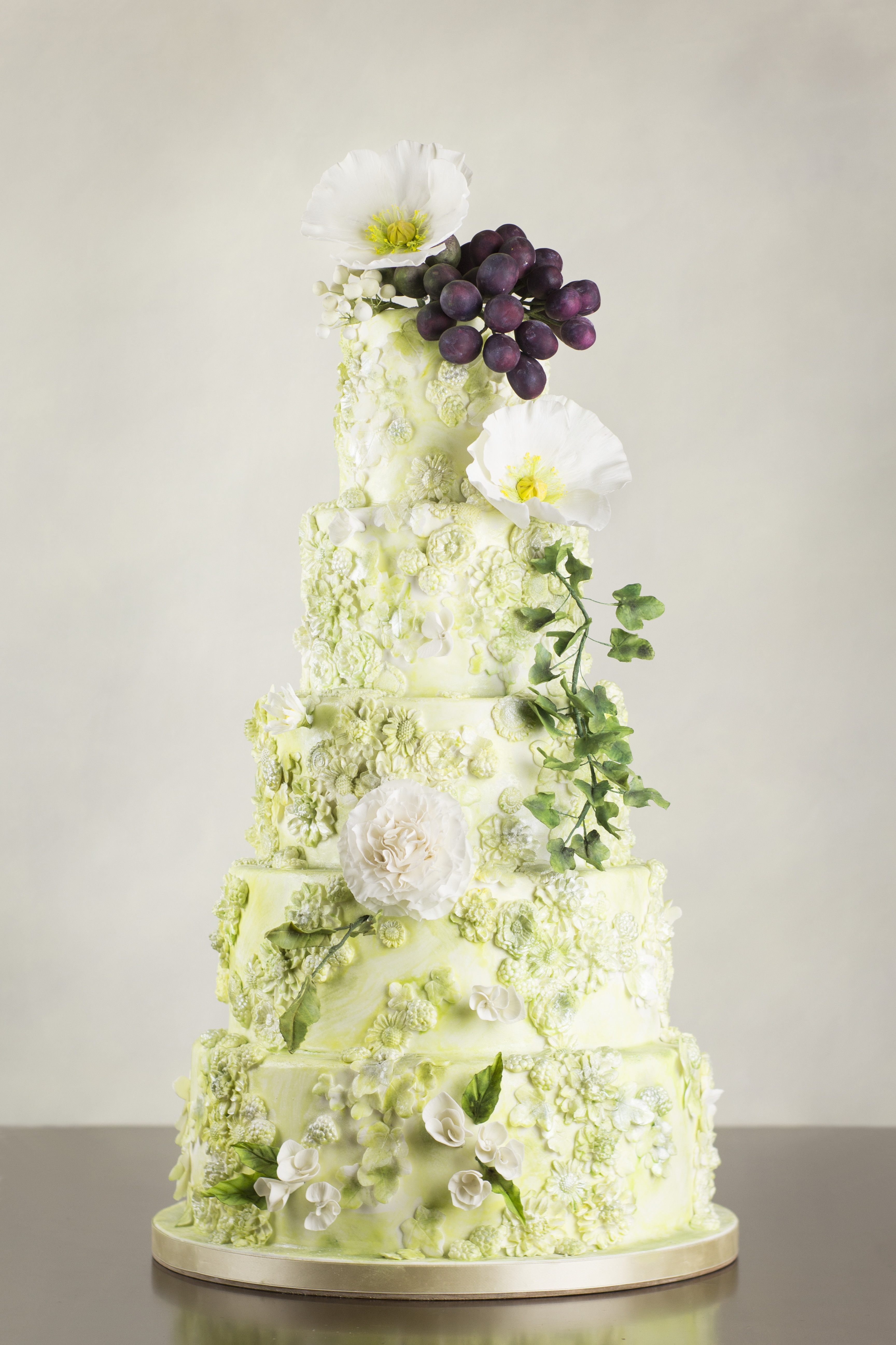 Yellow with white bas relief textured wedding cake