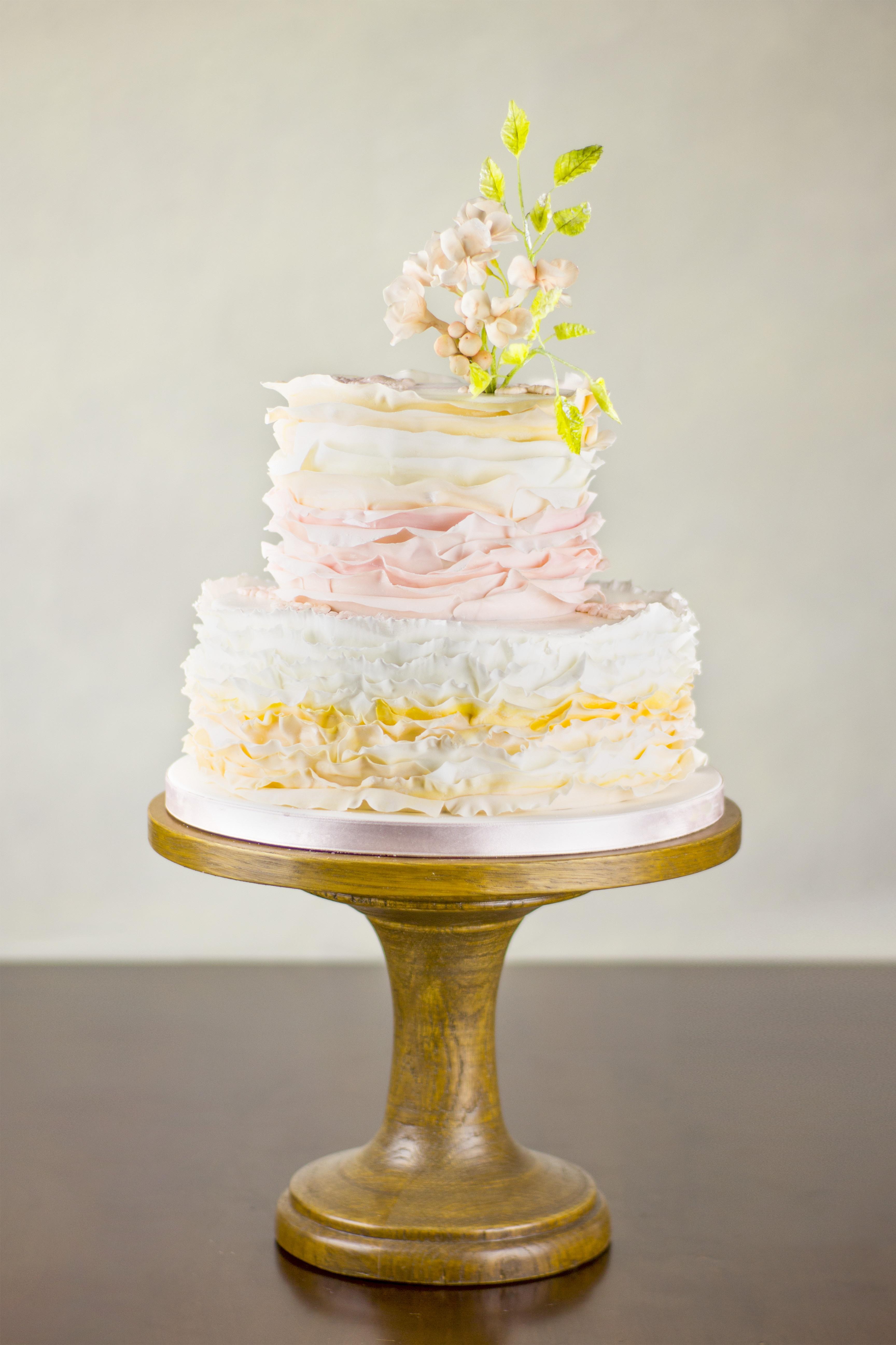 Pink and orange ombre ruffle wedding cake