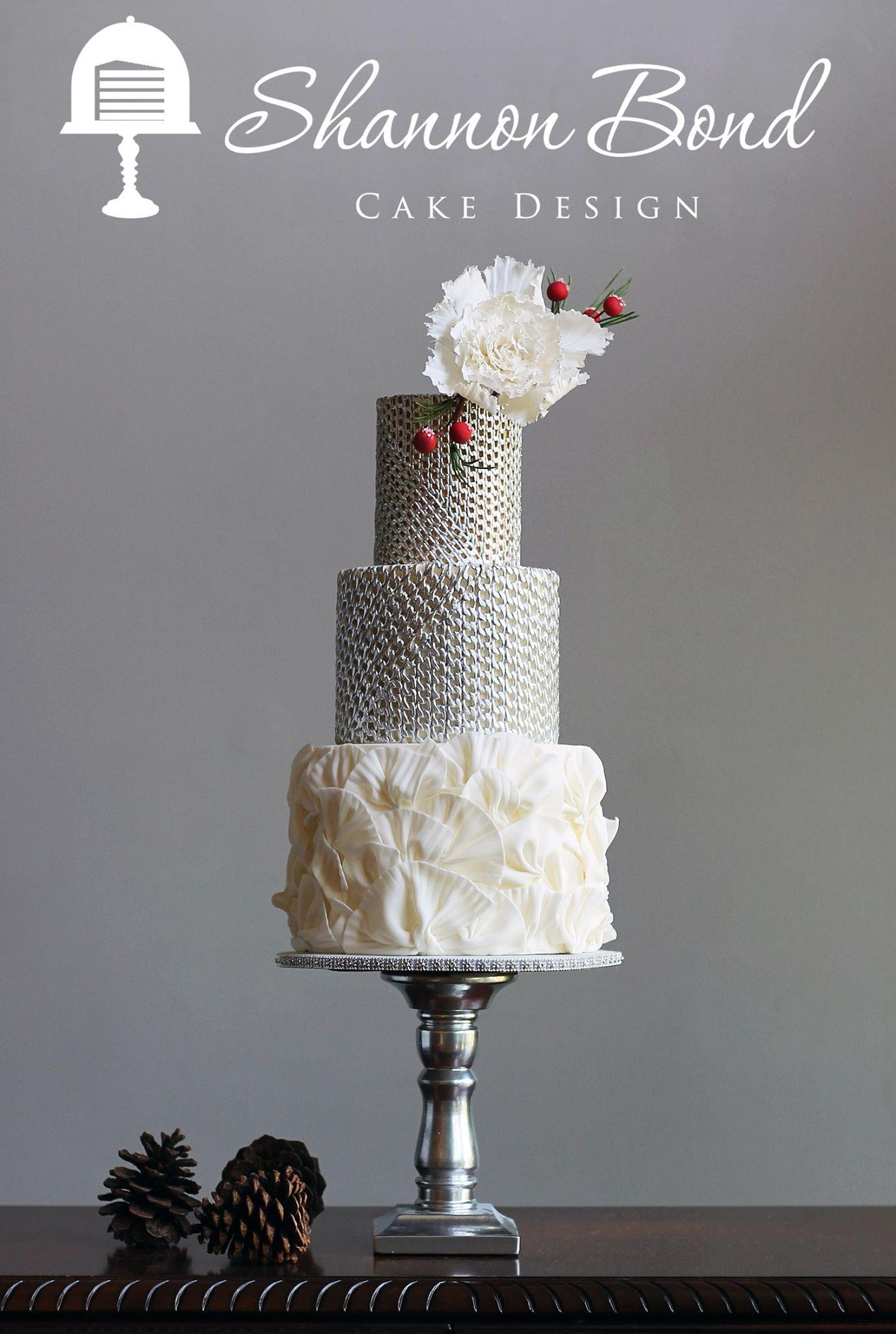 Silver sparkle and white winter wedding cake with ruffles