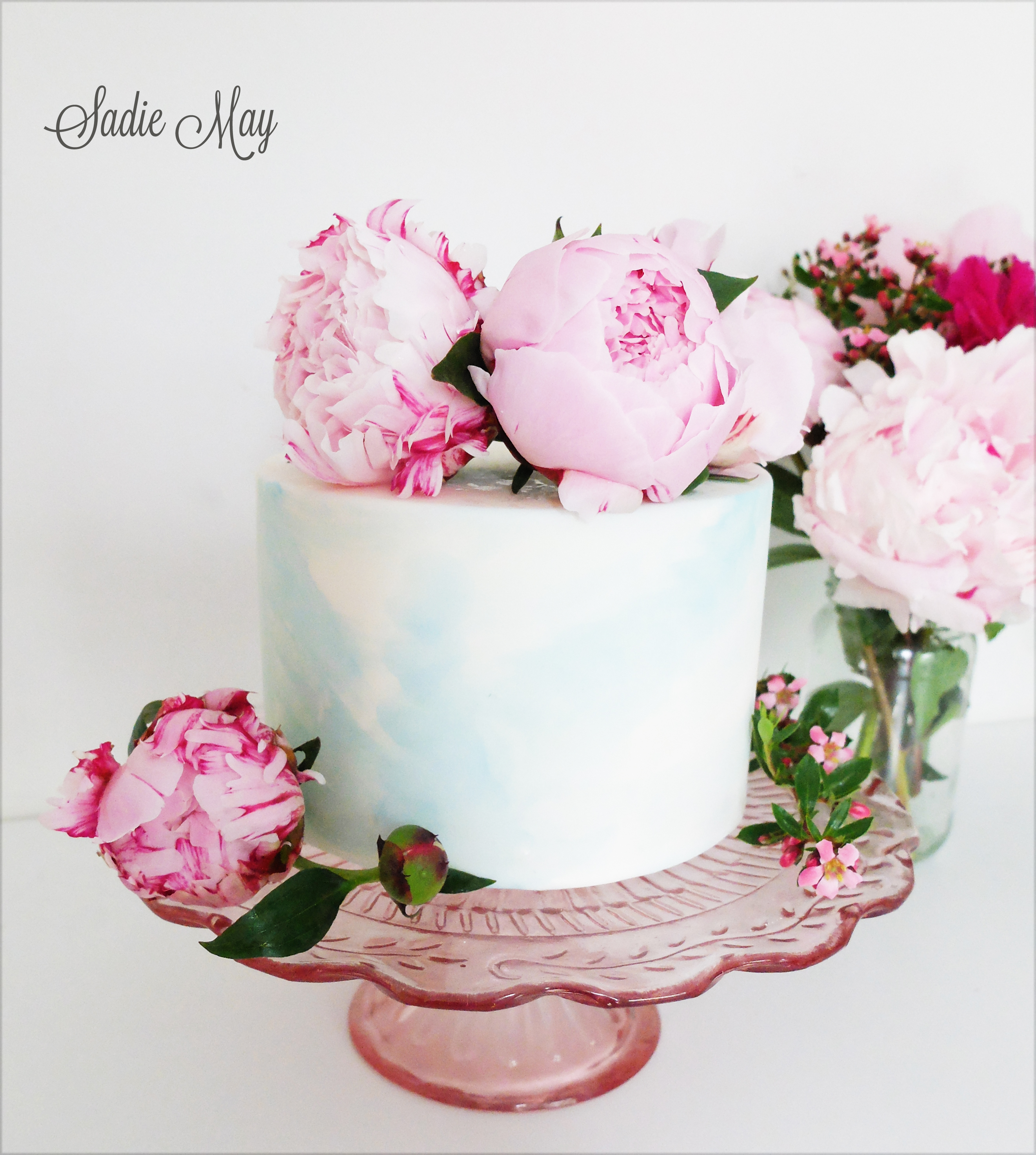 Mini baby blue marbled cake with pink sugar roses