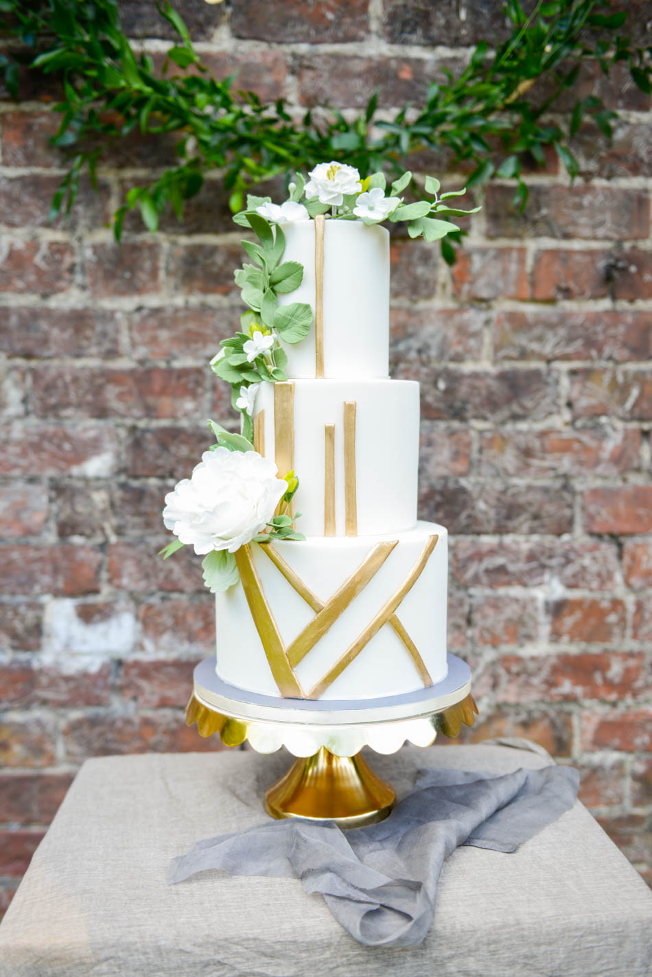 White wedding cake with gold accents