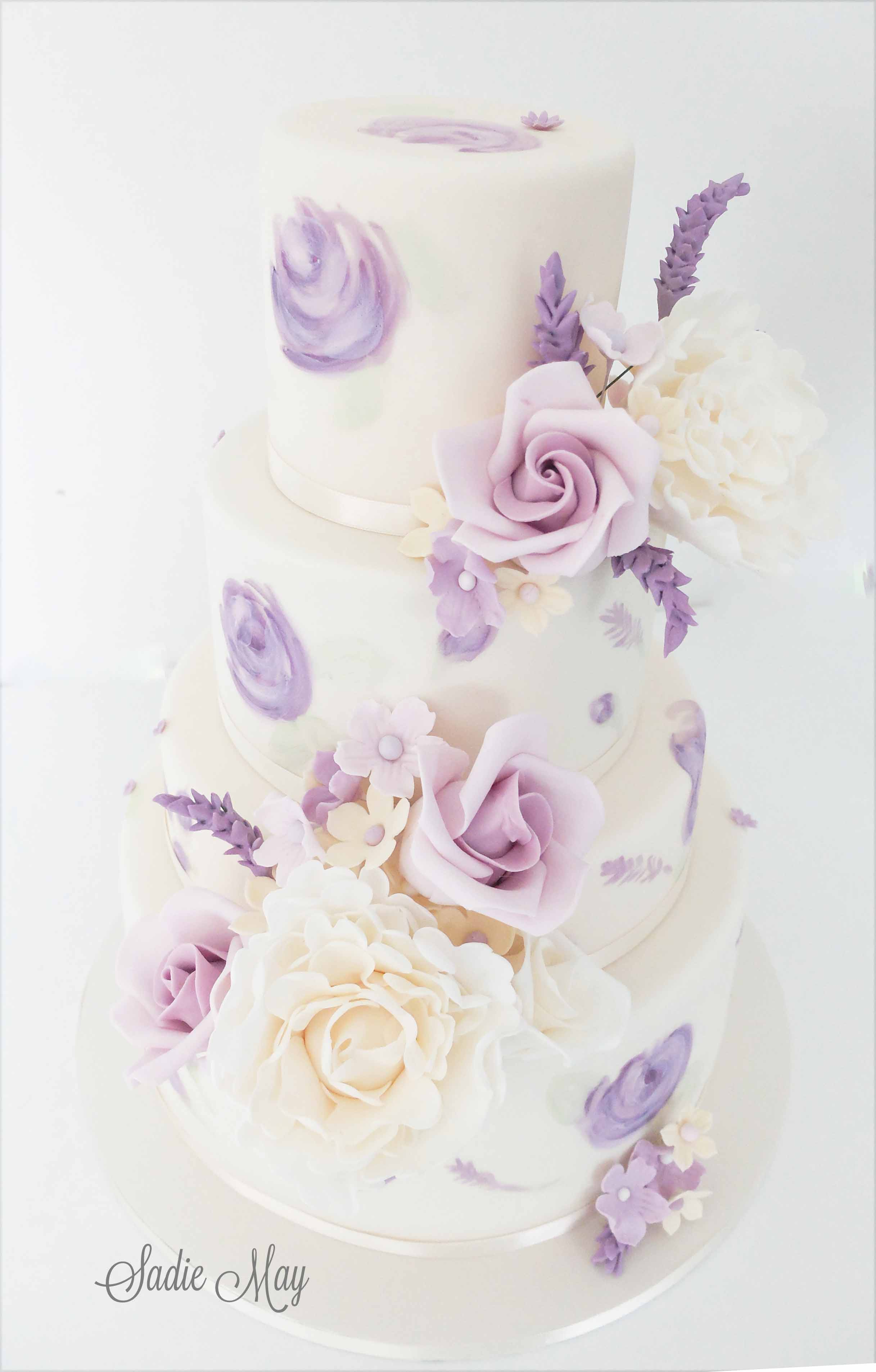 White Wedding cake with hand painted purple flowers