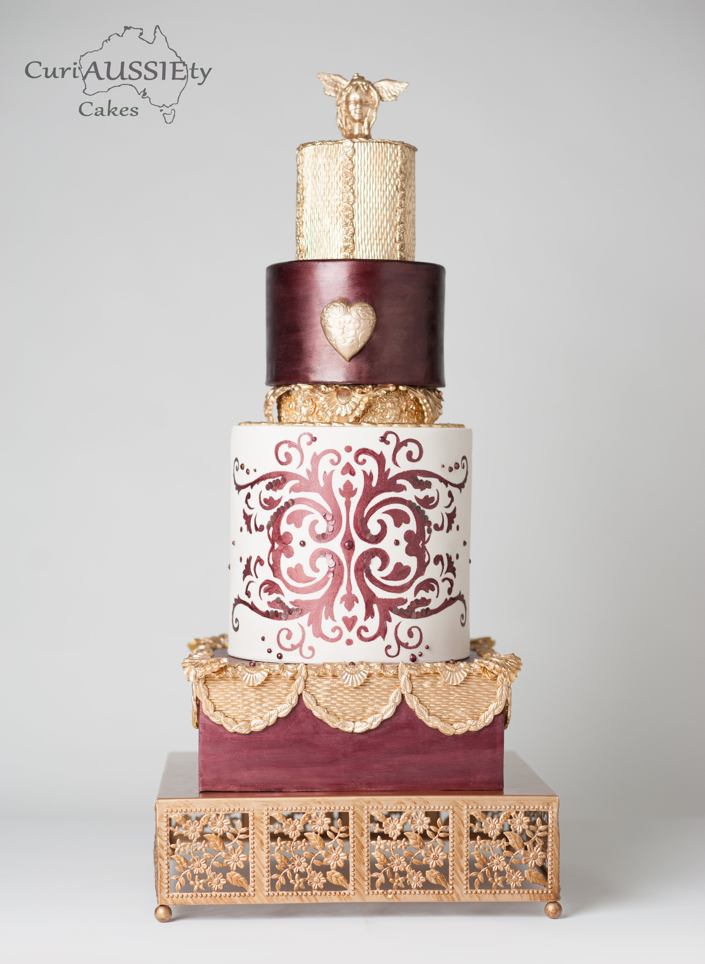 Burgundy and gold victorian wedding cake