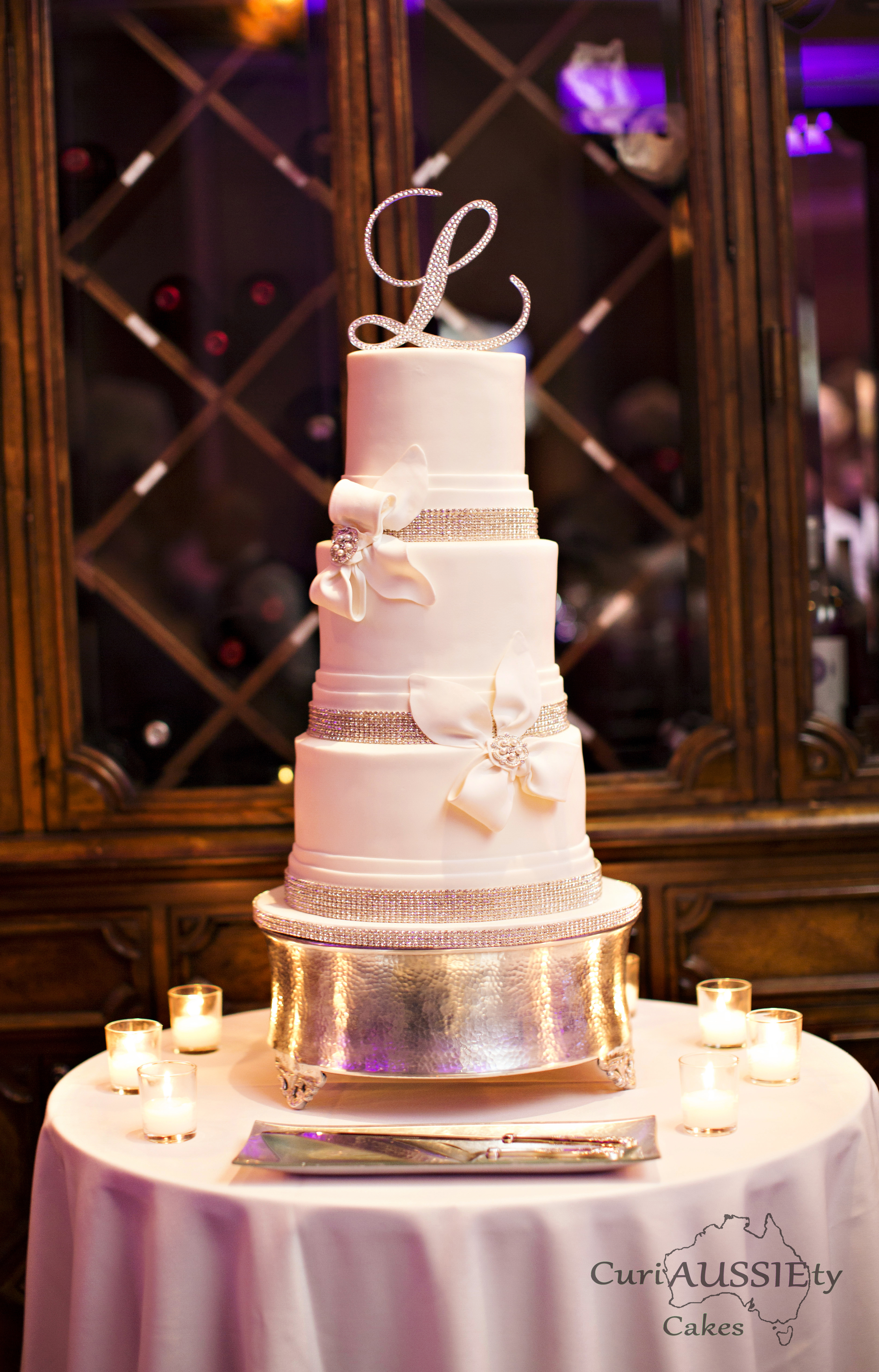 Ivory with bows wedding cake