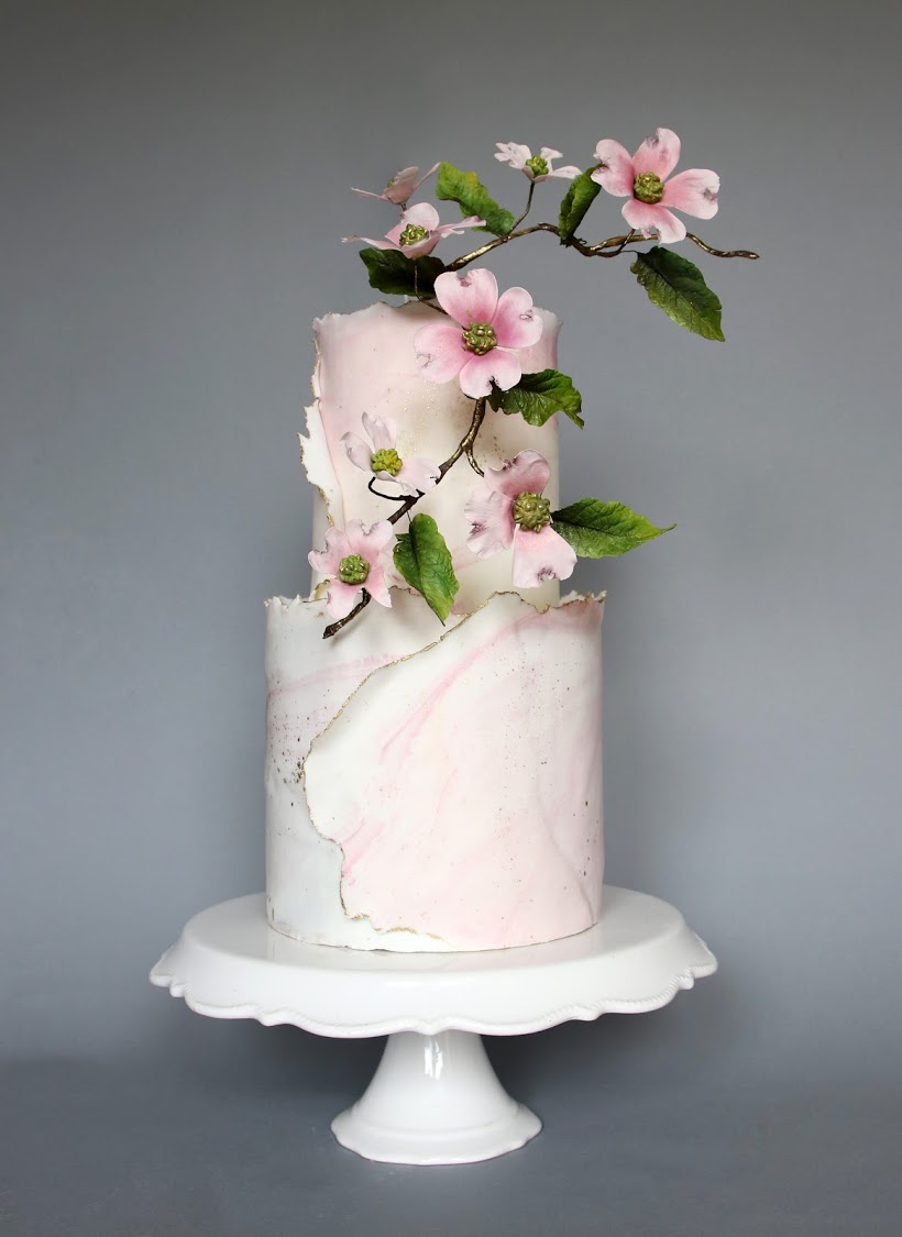 Baby pink wedding cake with sugar dogwood flowers