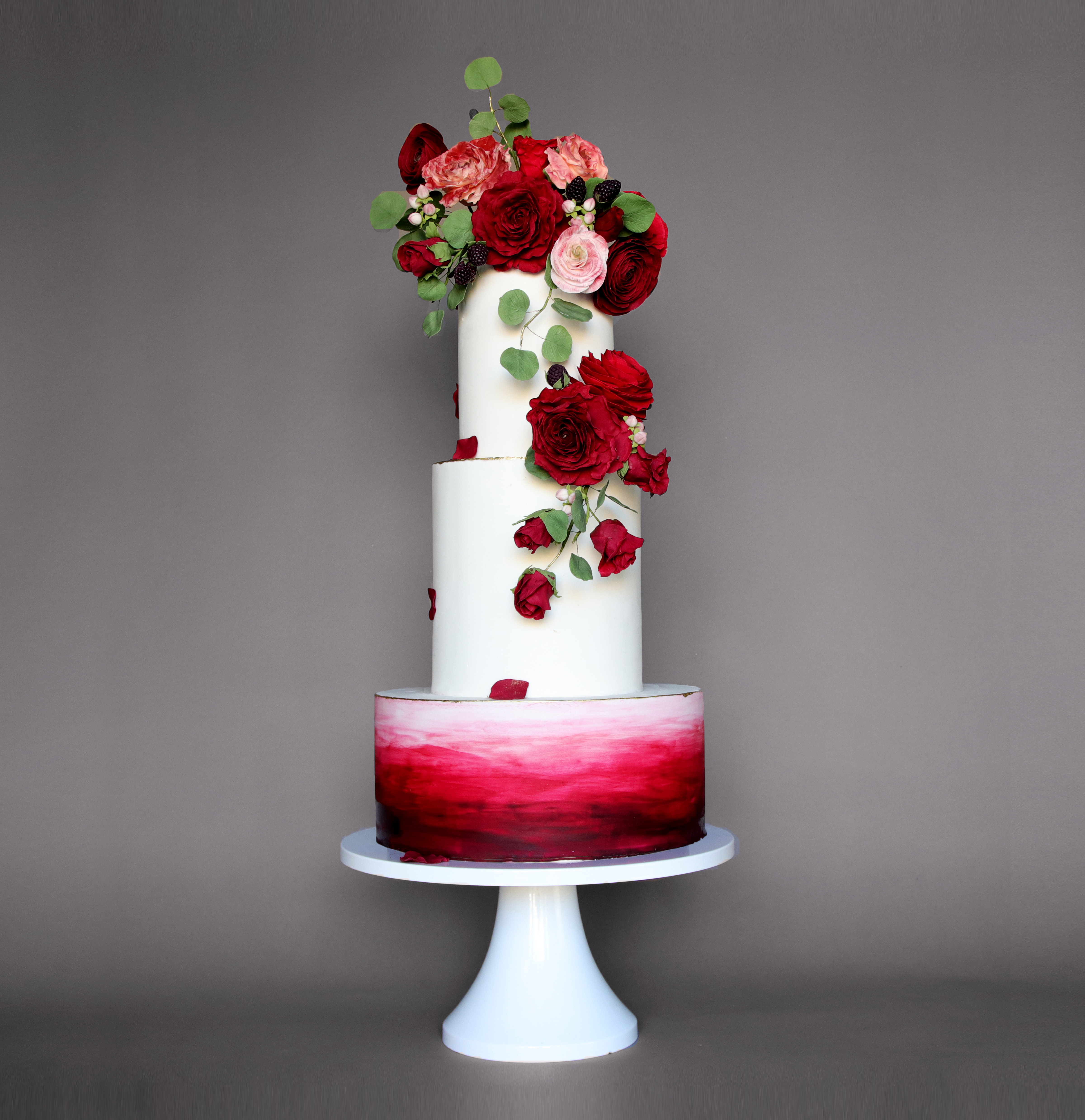 Red and white watercolor ombre wedding cake with sugar roses
