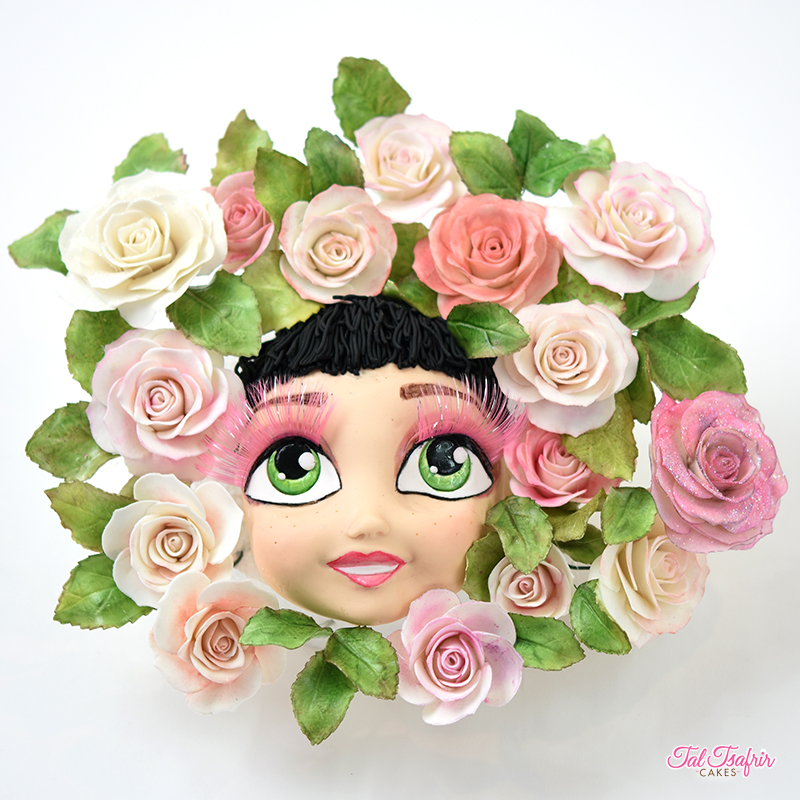 Woman figurine with a wreath of sugar flowers
