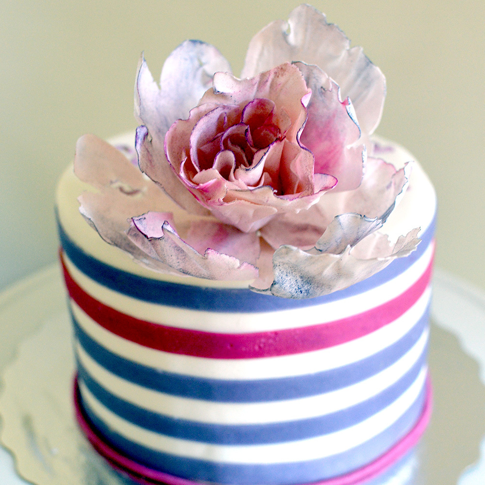 Striped mini cake with large gum paste sugar flower