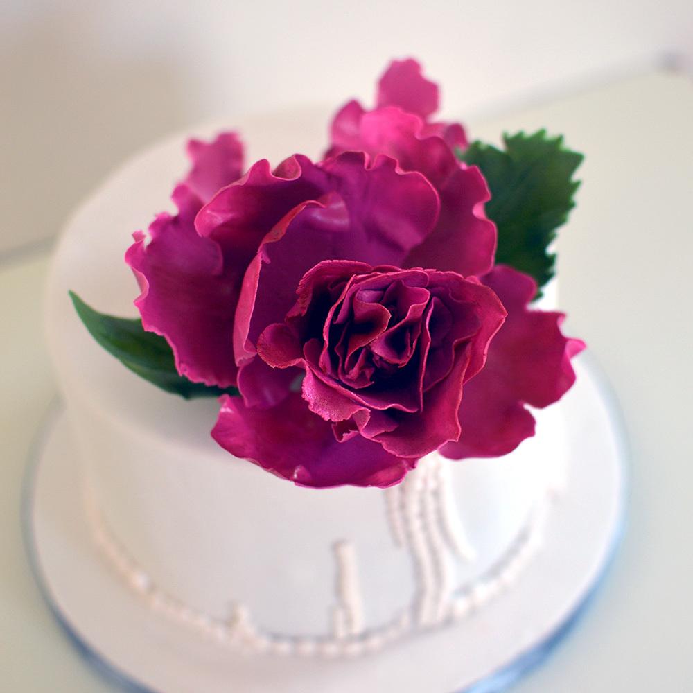 Mini cake with large gum paste sugar flower