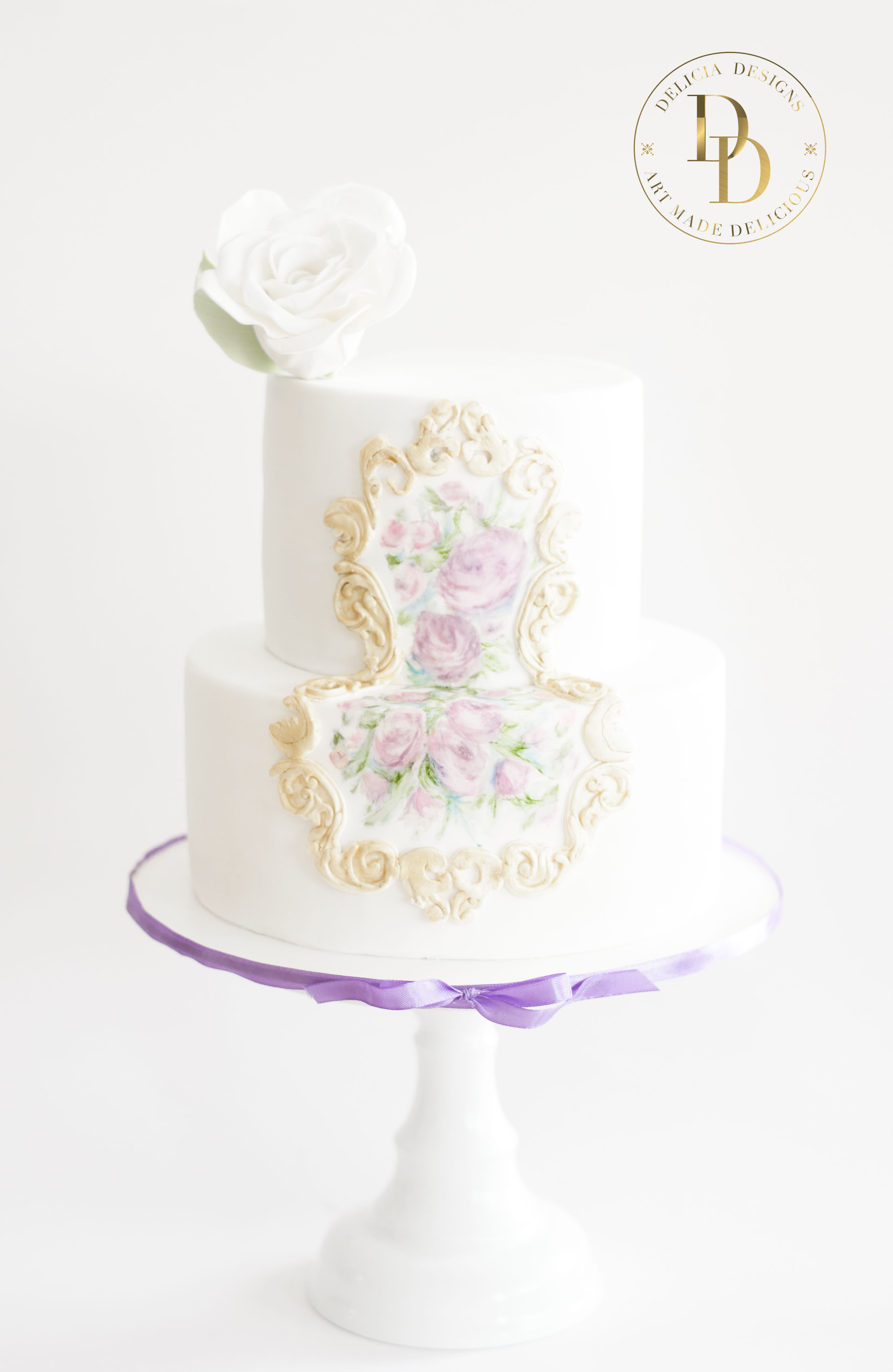 White Victorian Wedding cake with gold and hand painted flower