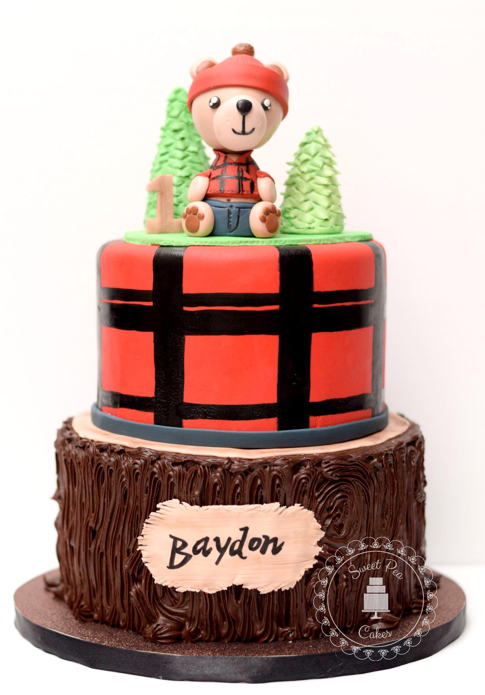 Brown and red fondant lumberjack woodland birthday cake