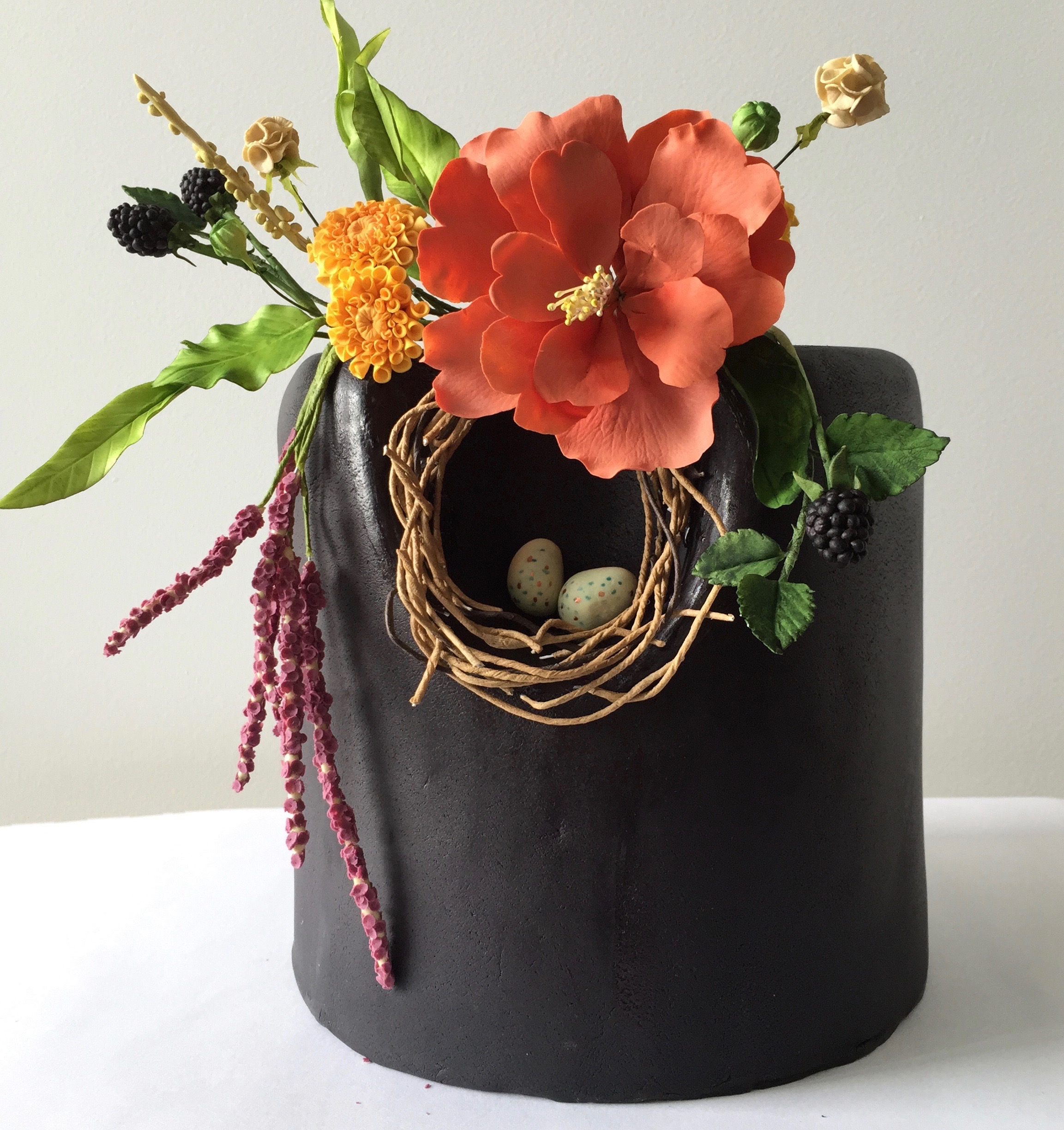 Black mini cake with red sugar flower poppies