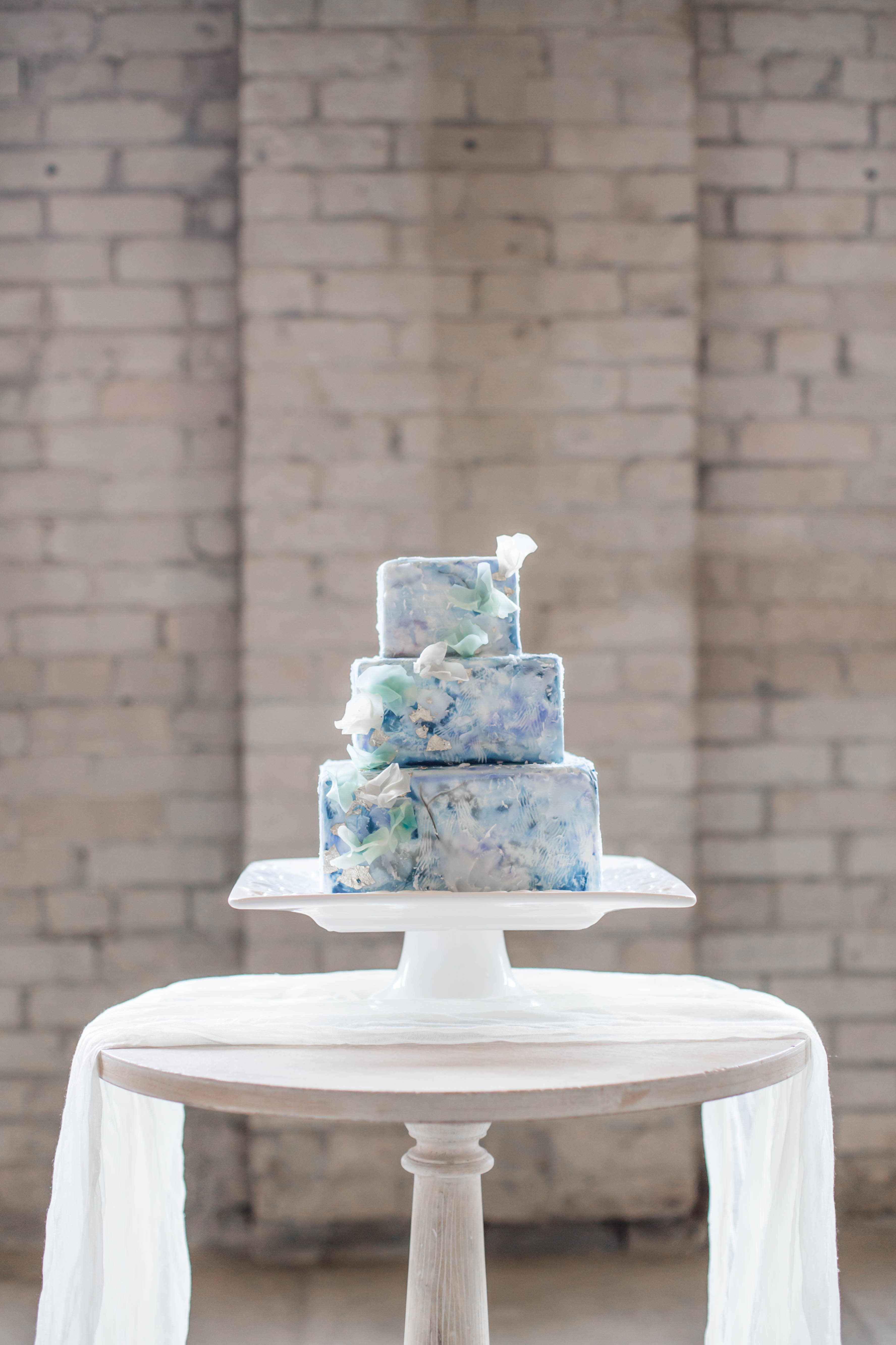 Blue watercolor painted wedding cake