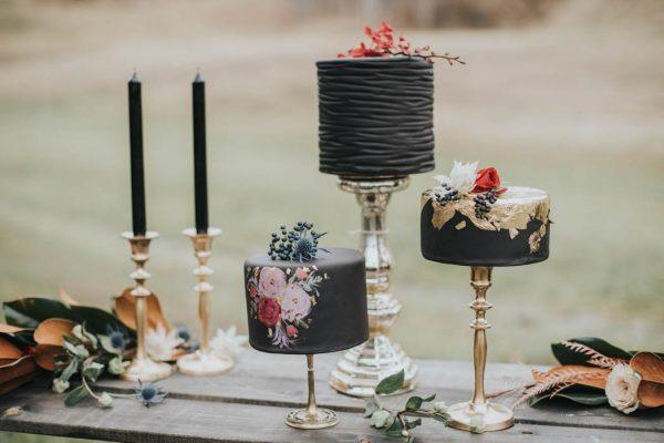 Trio of black mini wedding cake with hand painted flowers