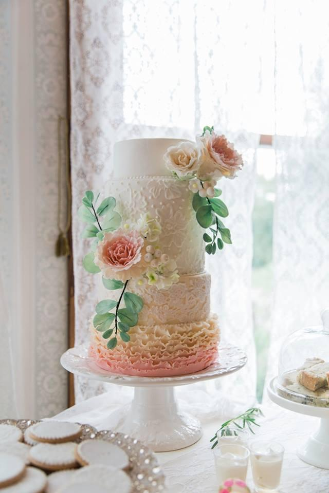 Pink ombre ruffle wedding cake with sugar flowers