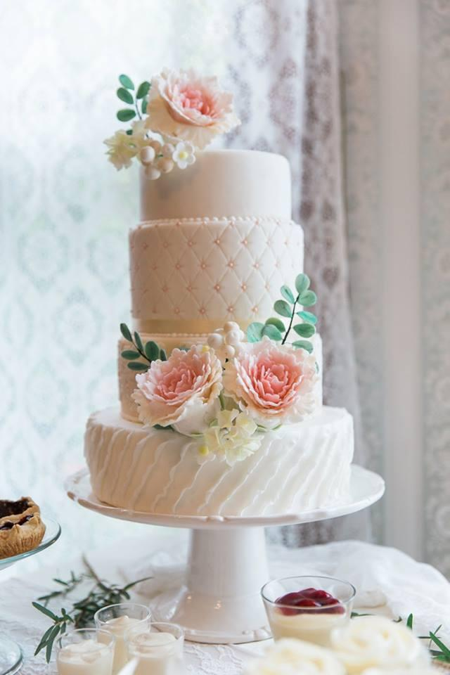 Light pink and white quilted wedding cake