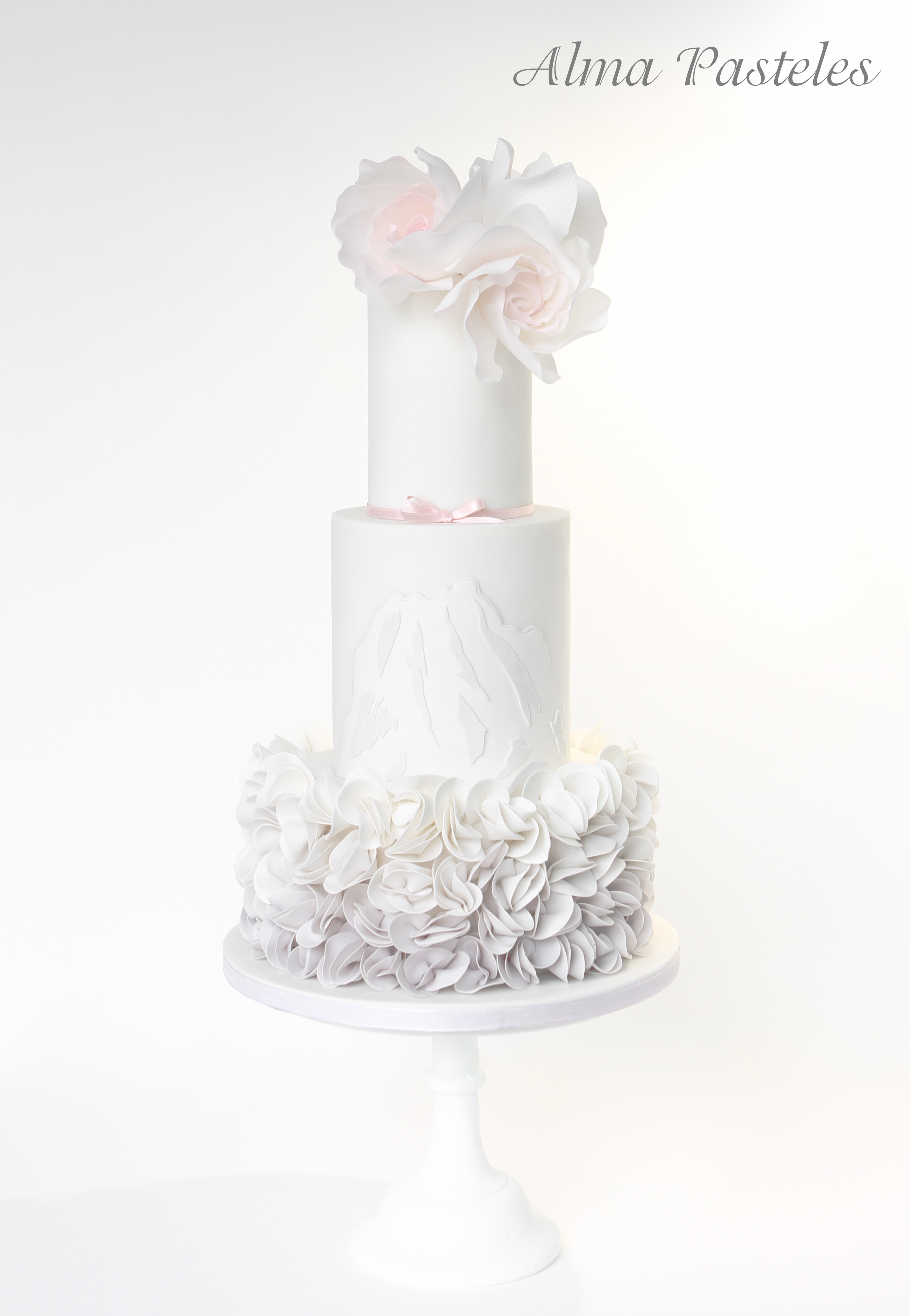 Gray and white ruffle wedding cake