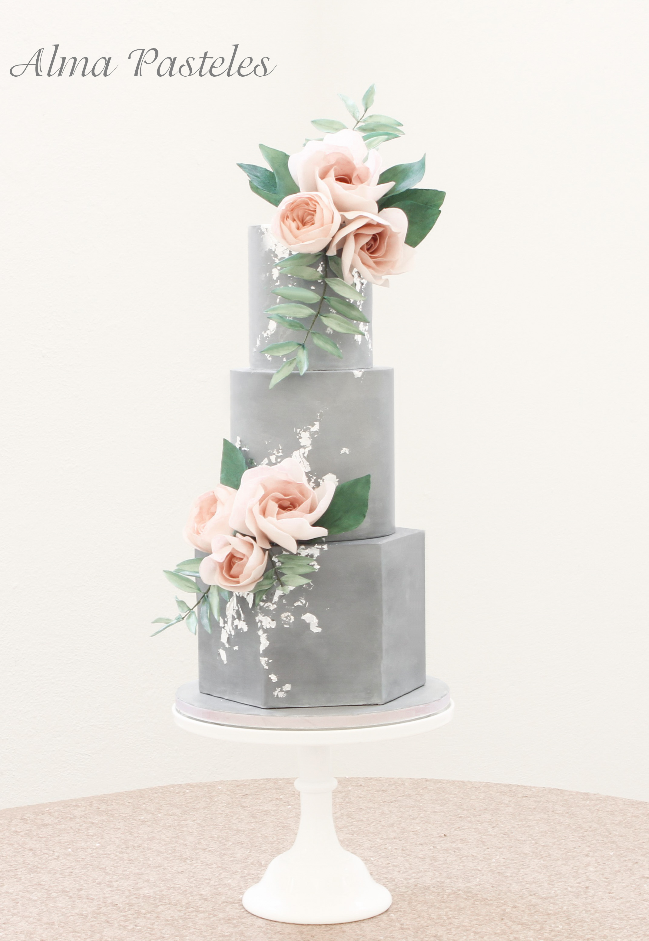 Gray wedding cake with pink sugar flowers