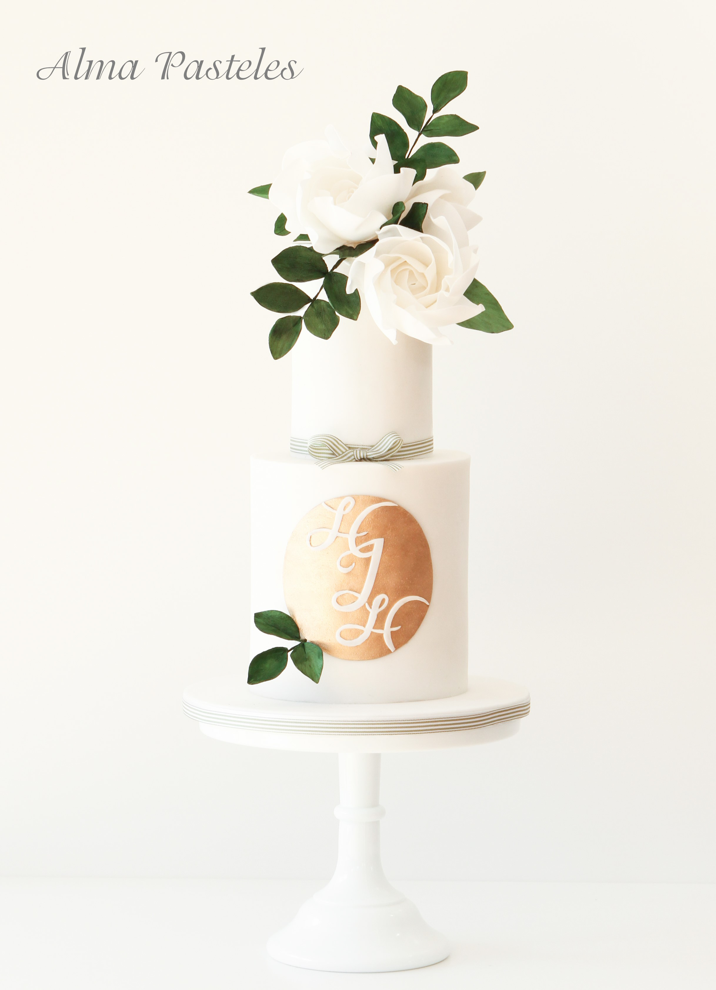 White and gold monogramed wedding cake