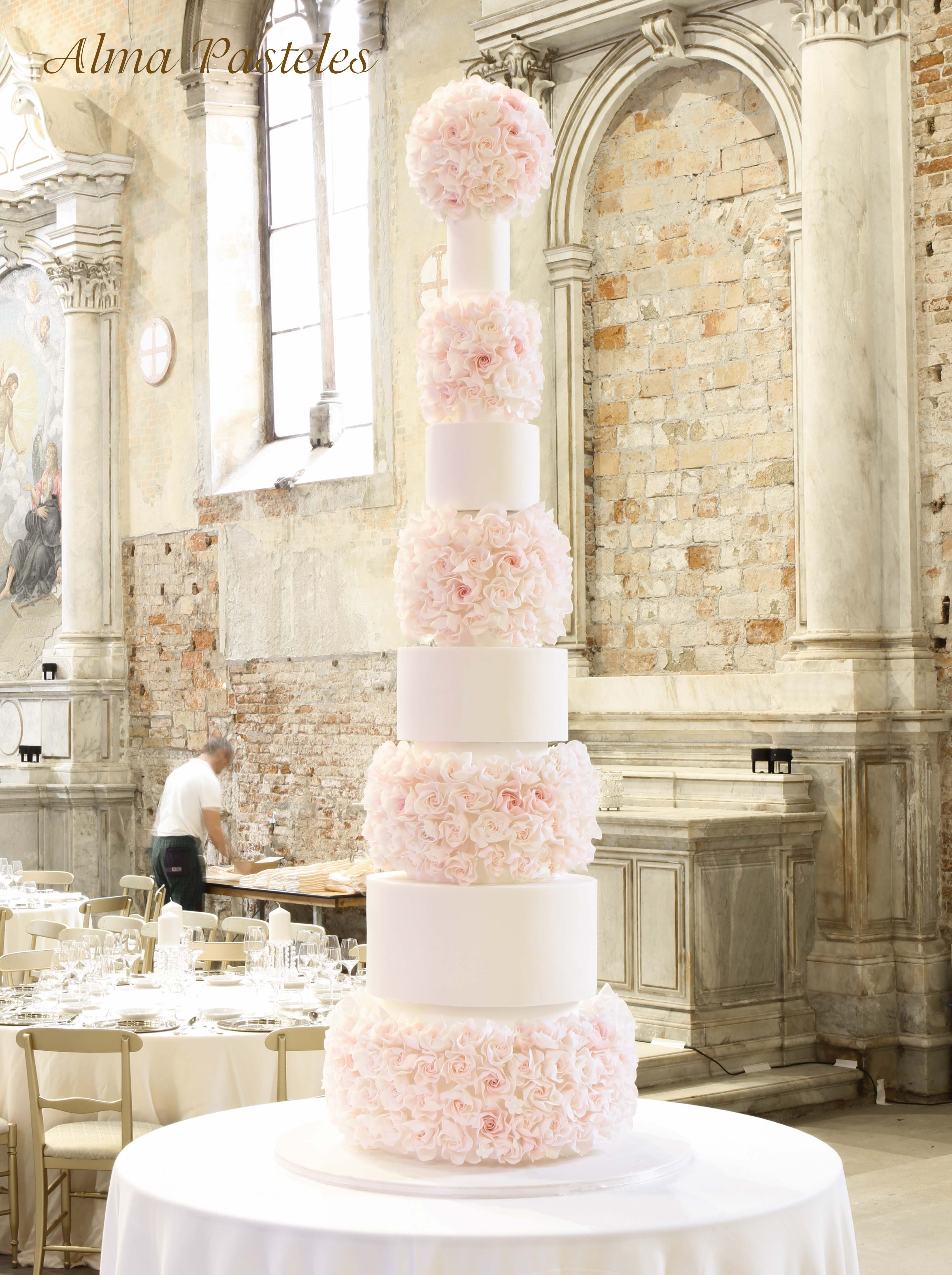 8 tier wedding cake with pink sugar flowers