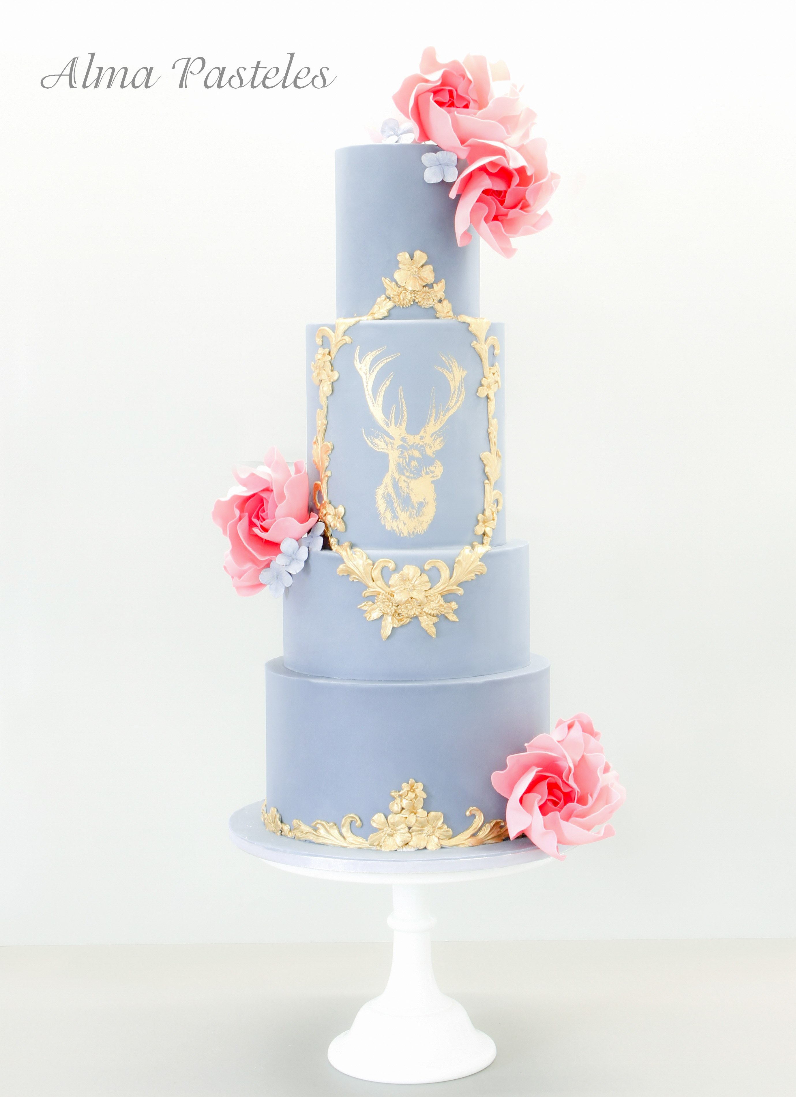Baby blue and gold victorian wedding cake with sugar flowers
