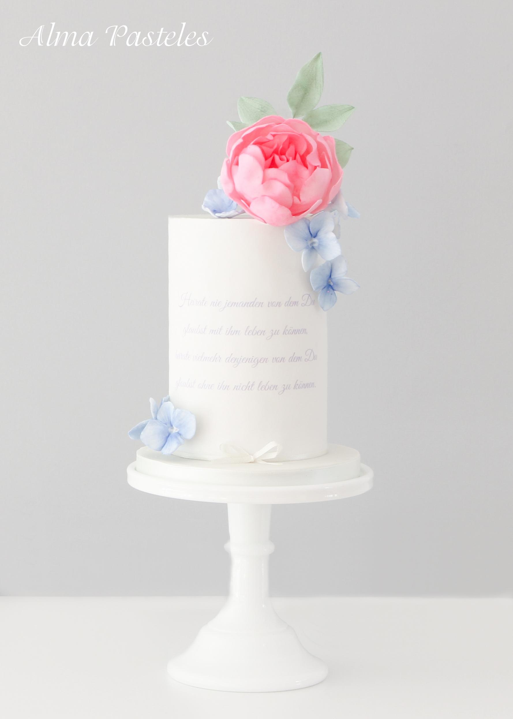 Monogrammed White wedding cake with pink sugar rose
