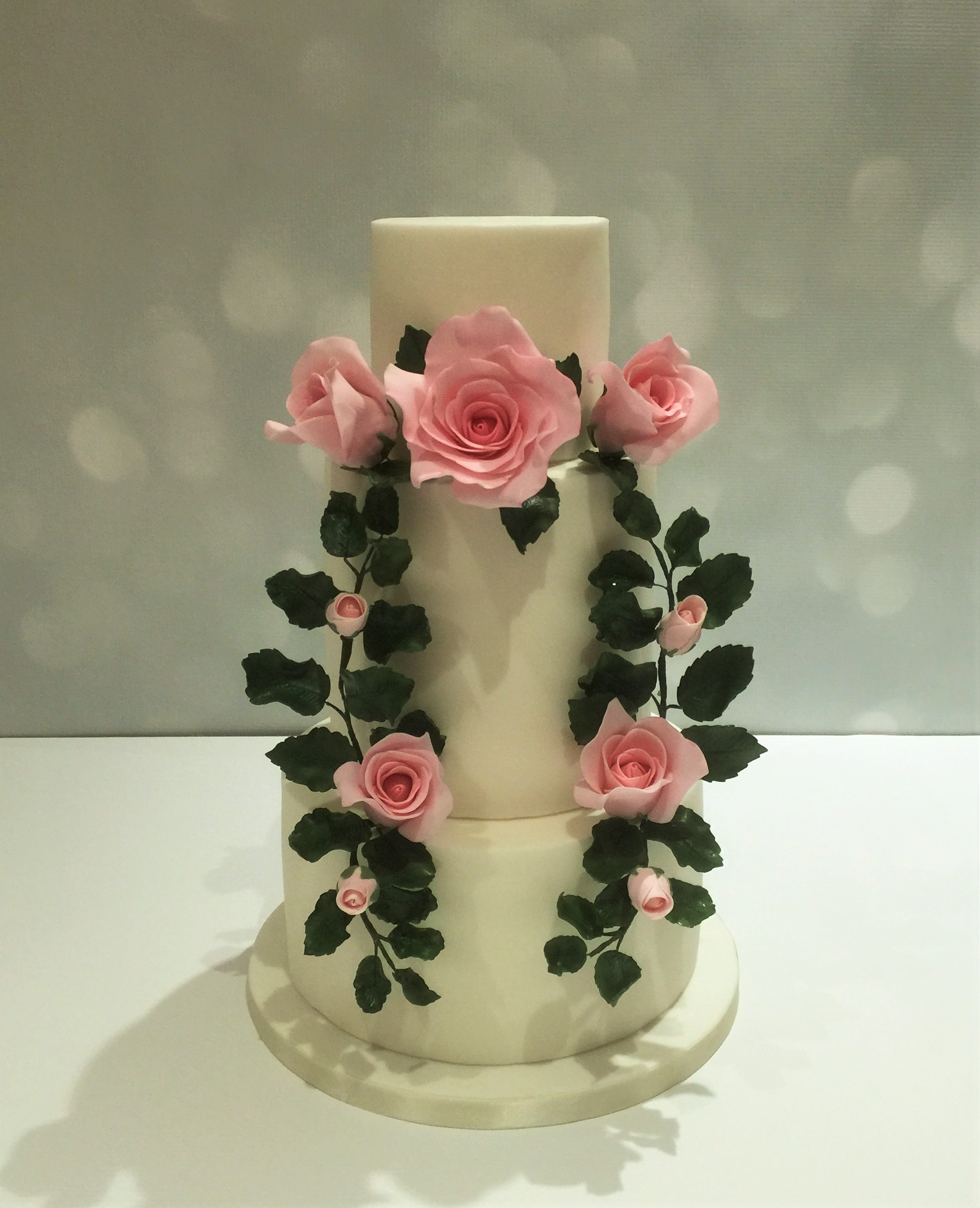 White Wedding with pink sugar flower wreath