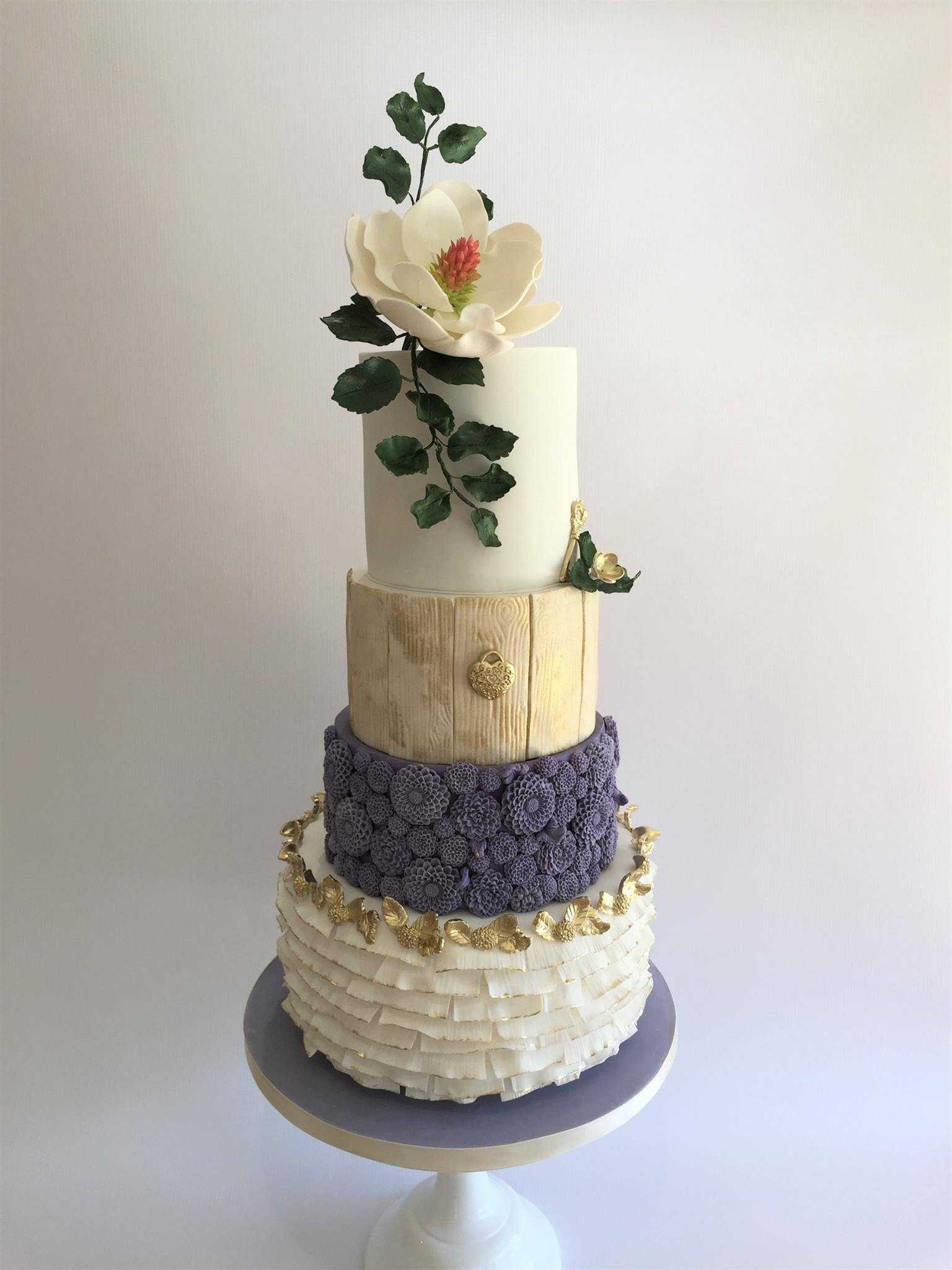 Ivory and purple rustic ruffled wedding cake