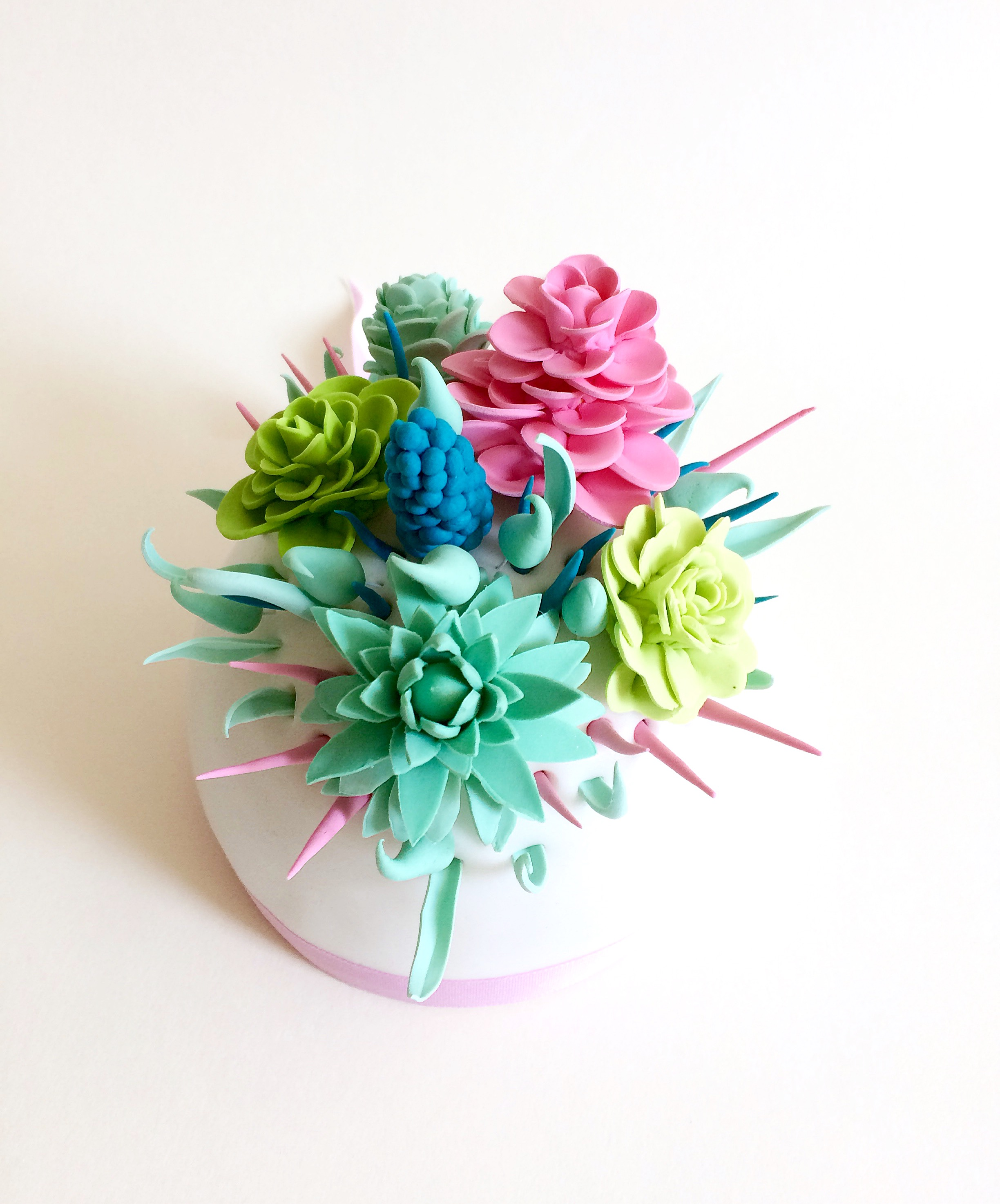 Bright sugar flower bouquet cupcake