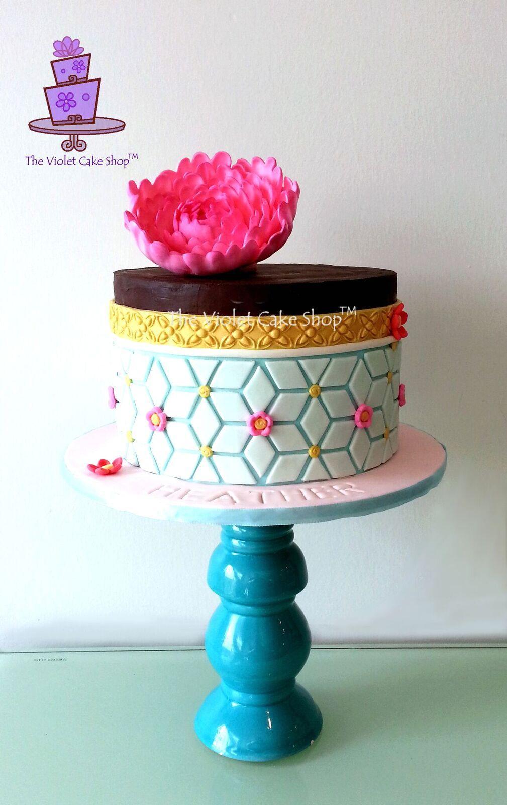 Turquoise and gold mini geometric cake