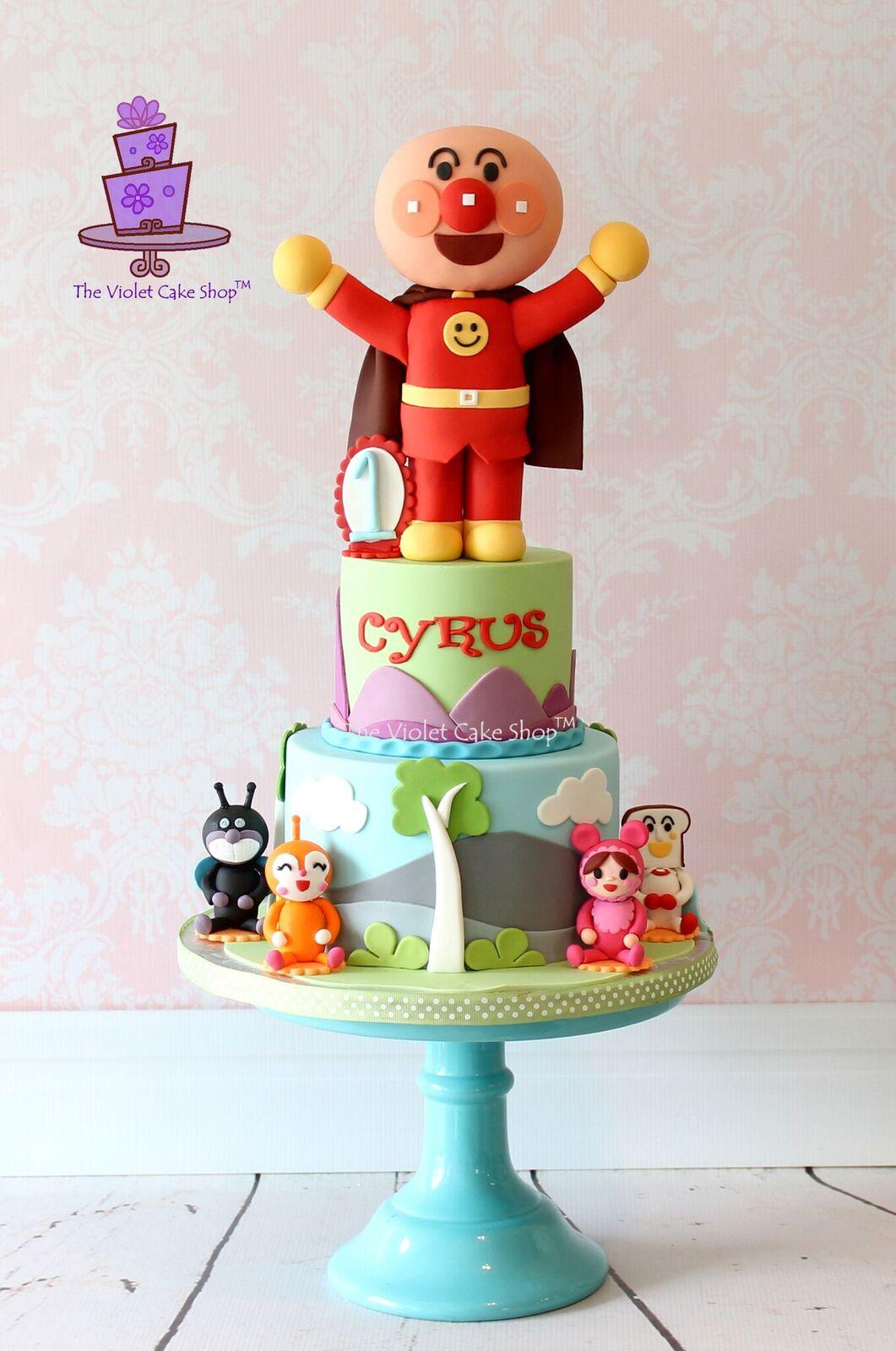 Caped boy birthday cake
