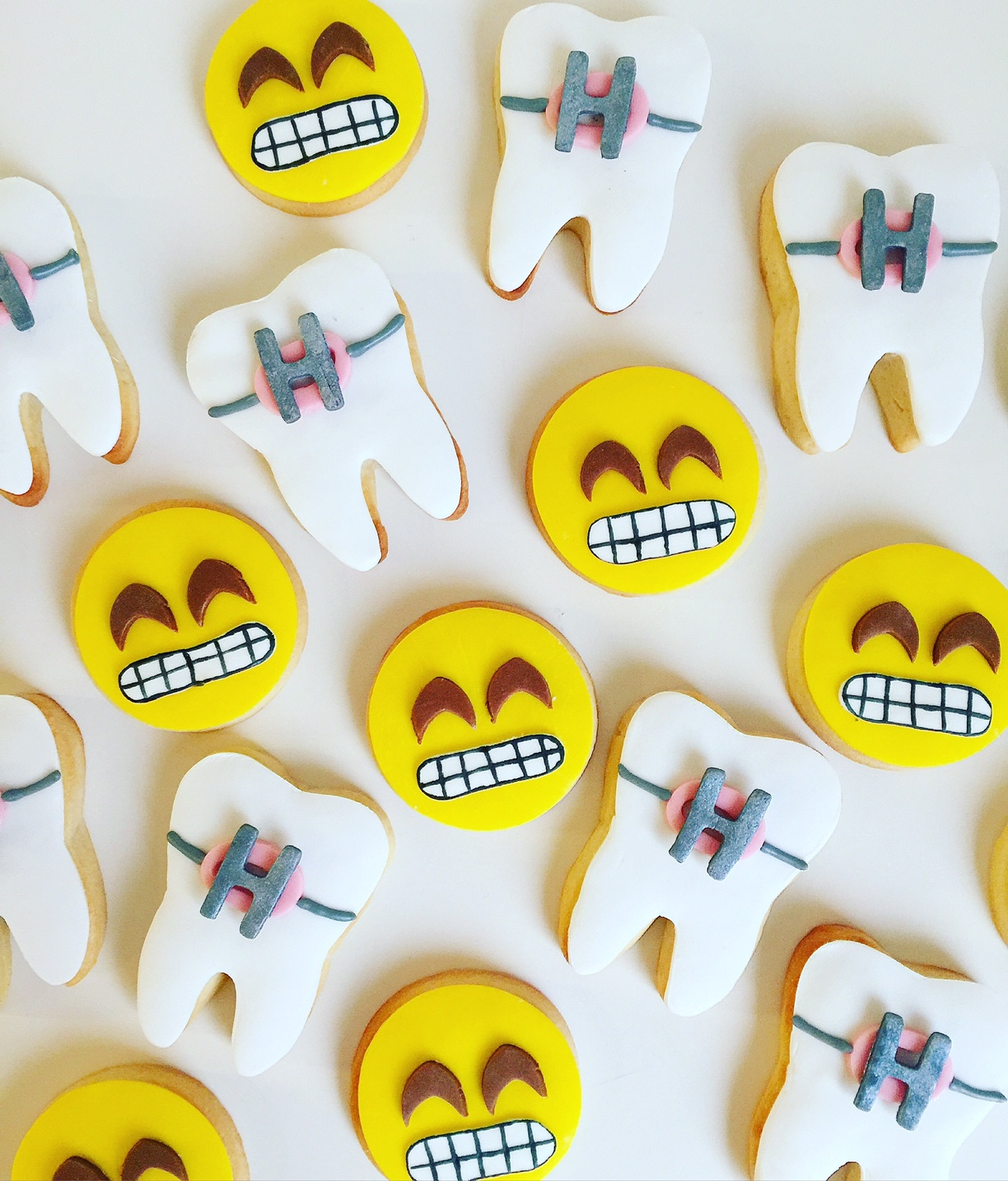 Yellow and white face and tooth fondant cookies