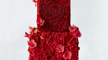 All red wedding cake with rosettes and ruffles