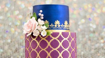 Burgundy and blue wedding cake with gold accents