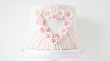 Baby pink mini wedding cake with heart on front