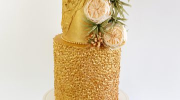 Gold sequin wedding cake with sugar flowers