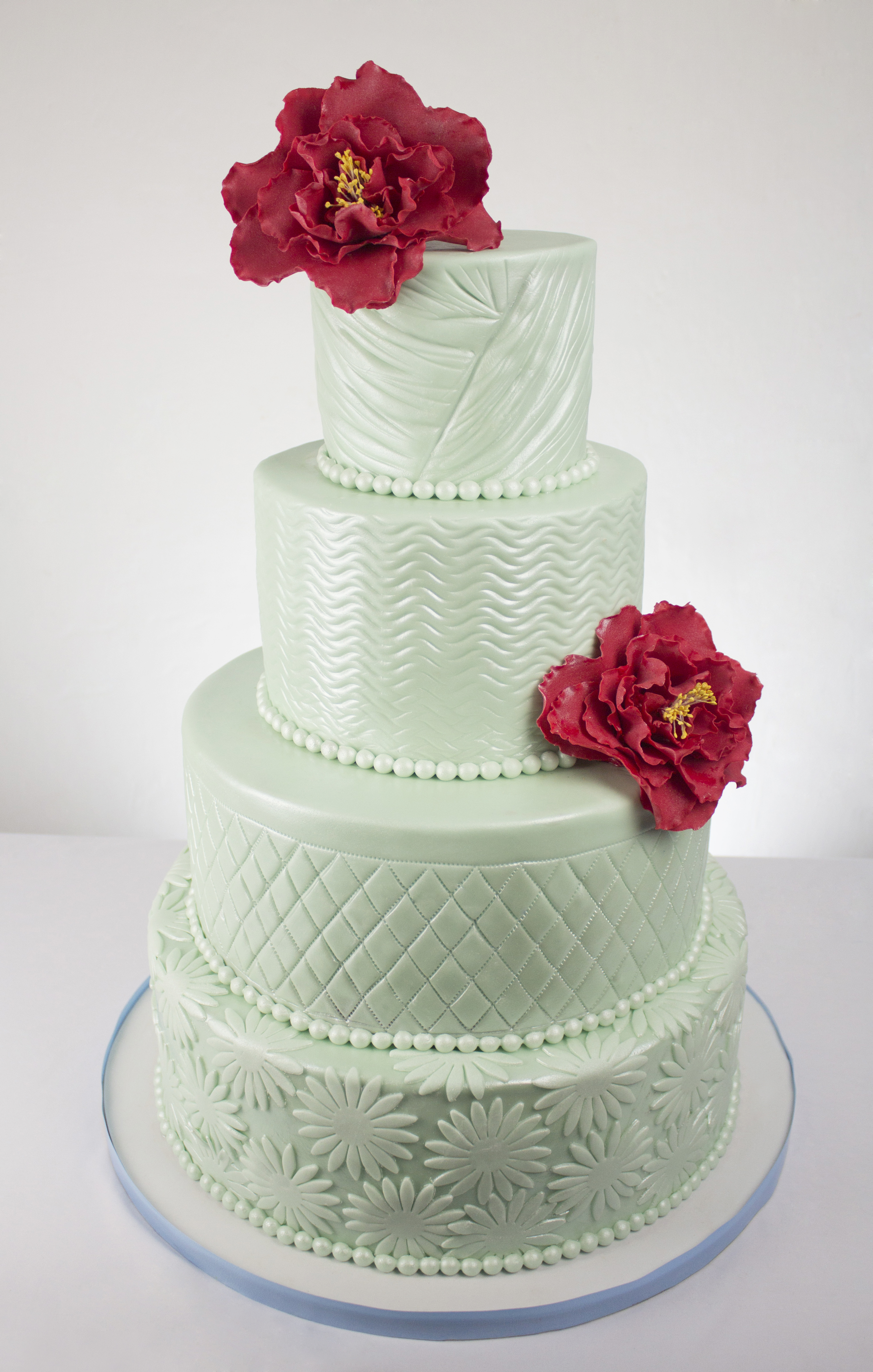 Pastel Green Wedding cake with red sugar flowers