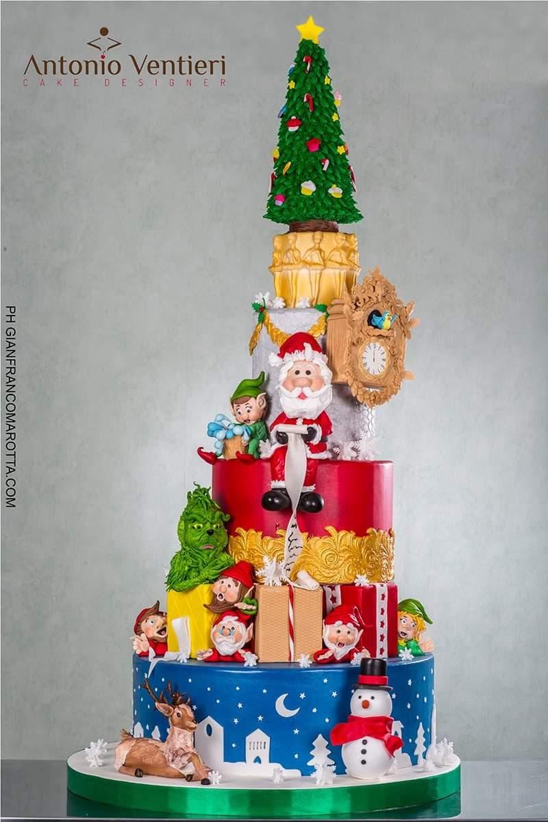 Santa snowman and reindeer themed Christmas cake