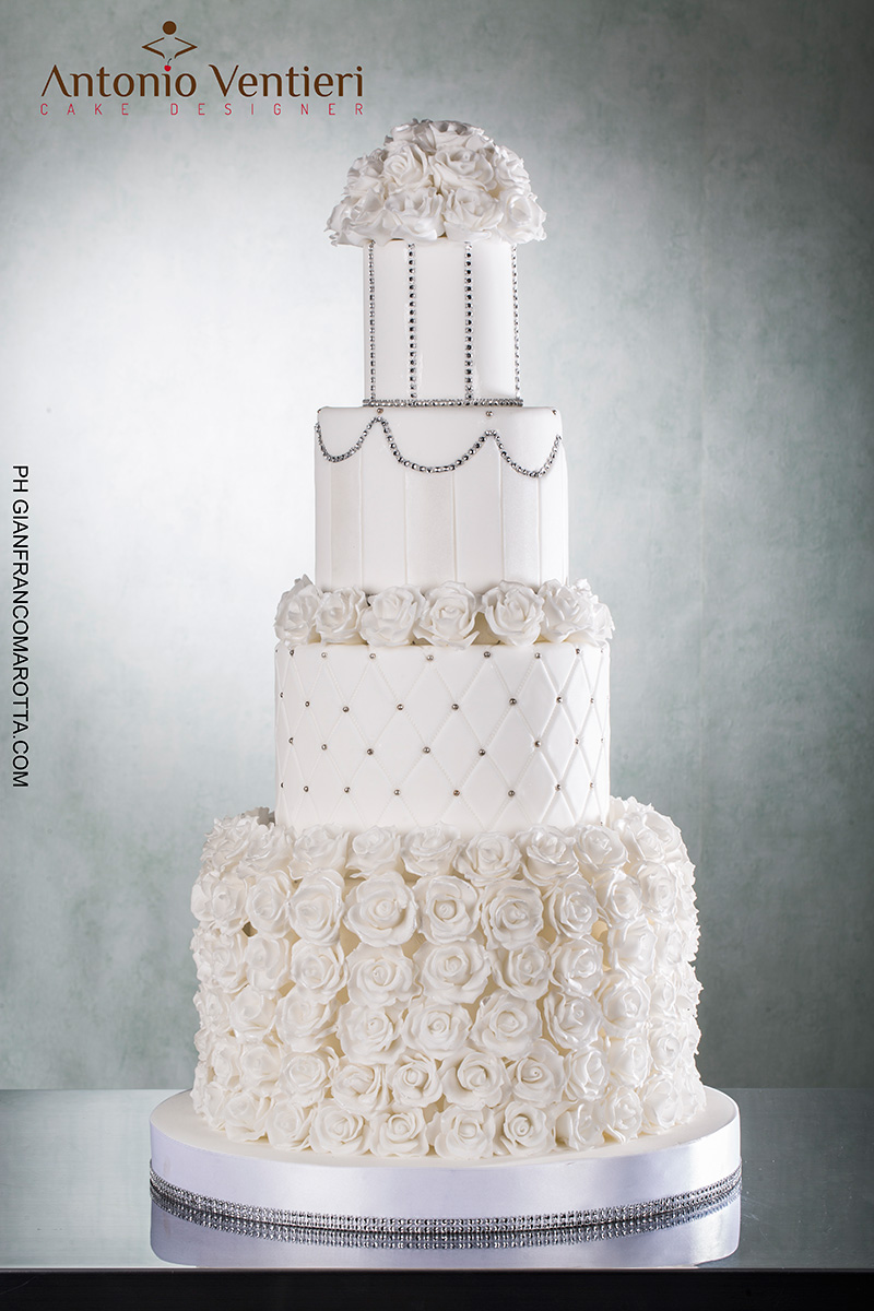 All white wedding cake with sugar rosettes