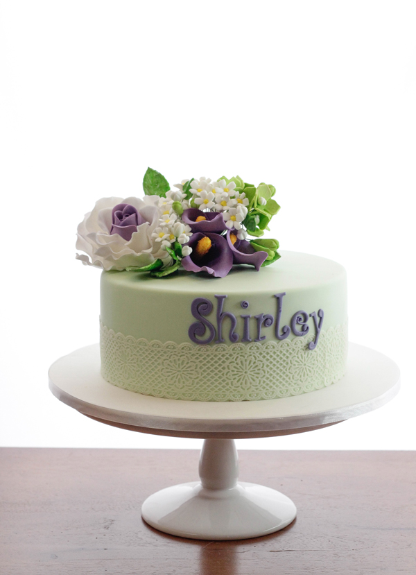 Mini pastel green cake with sugar flowers