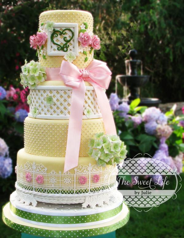 Pastel yellow wedding cake with green detailing