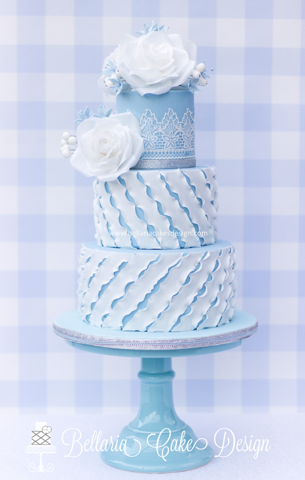 Pastel blue and white wedding cake with sugar flowers
