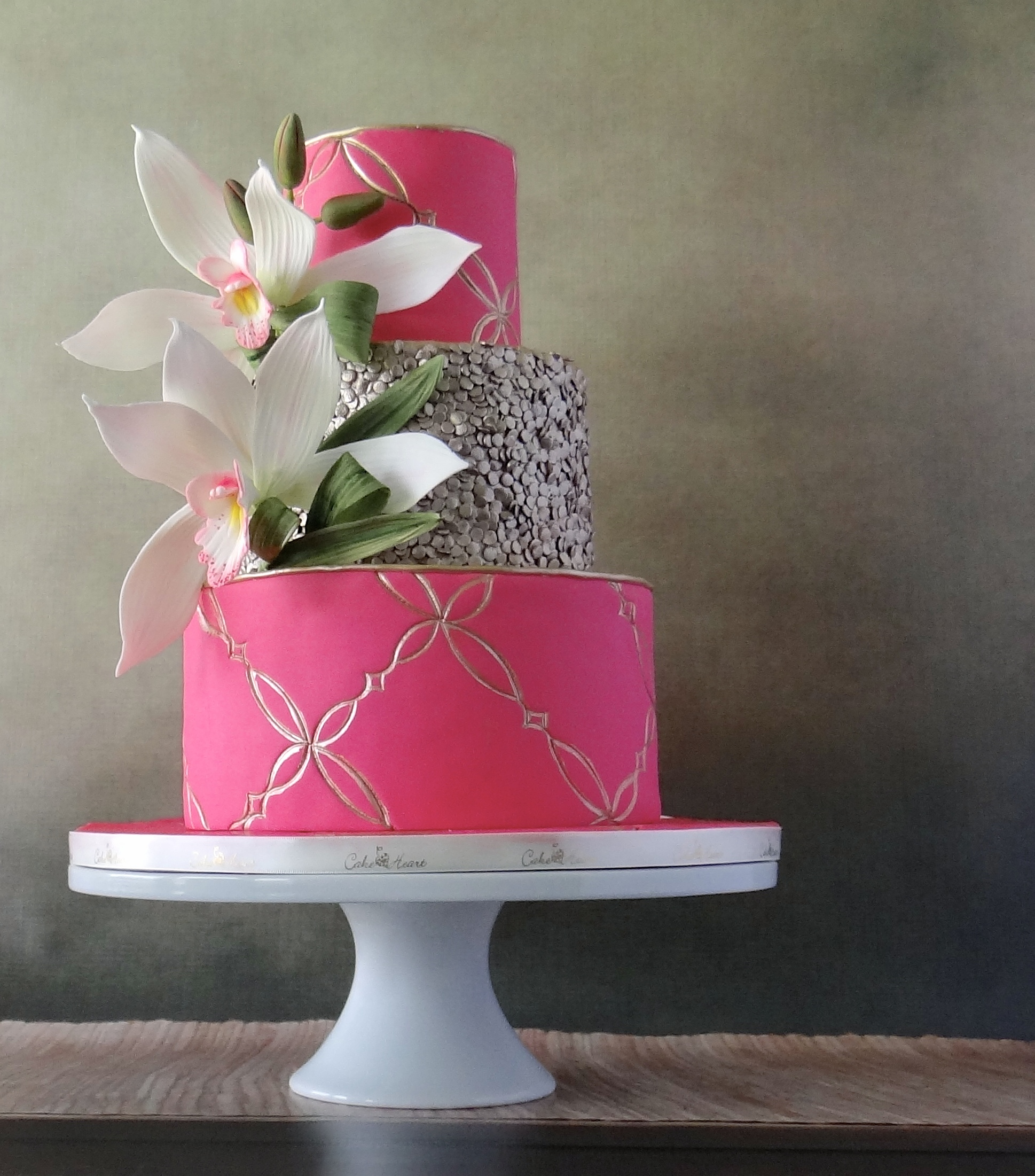 All pink wedding cake with silver details
